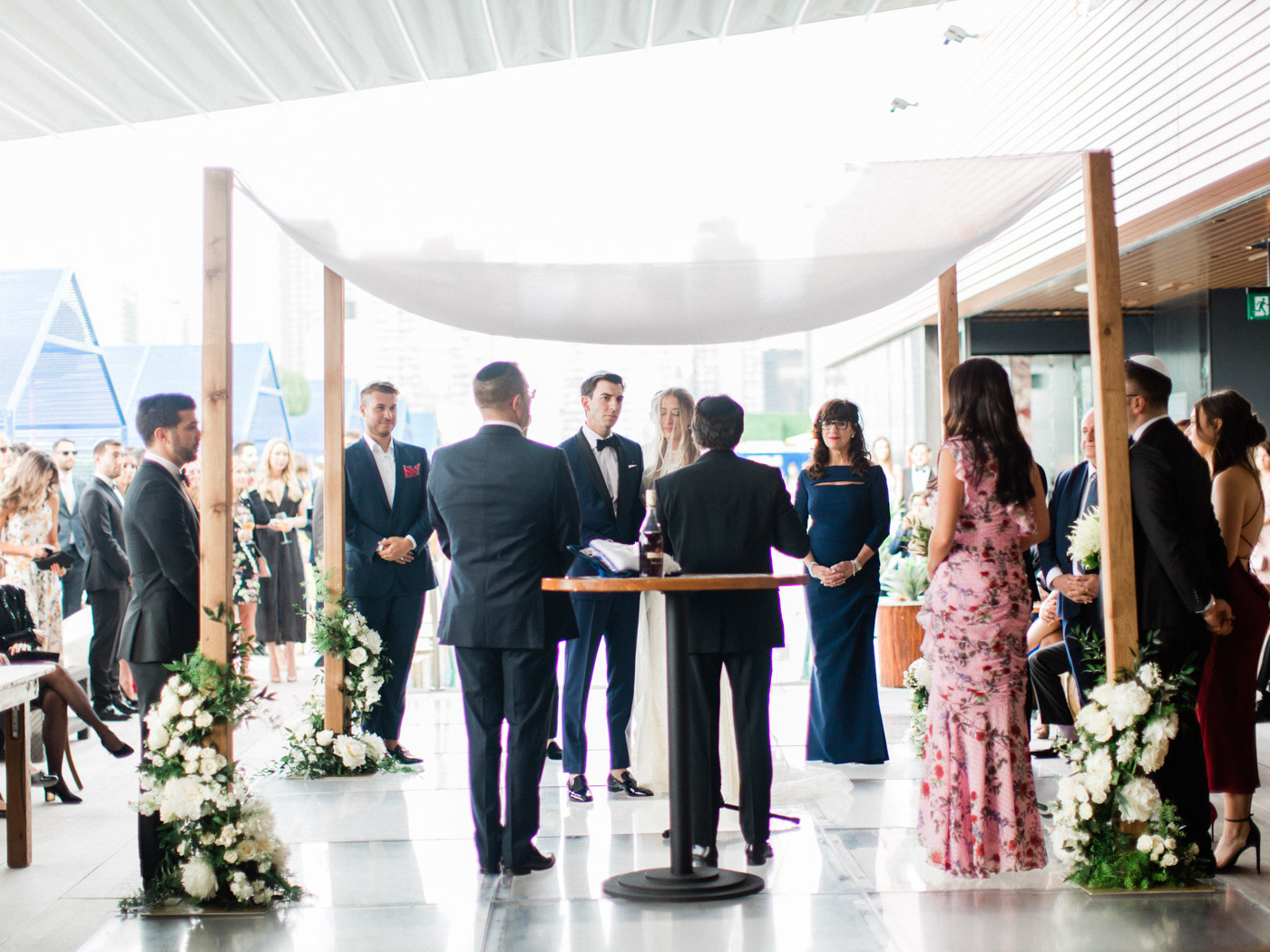 -bride and groom getting married under chuppah at their traditional jewish wedding. Captured by Toronto wedding photographer Corynn Fowler Photography