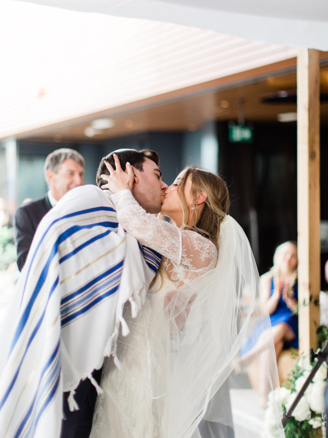 -	bride and groom getting married under chuppah at their traditional jewish wedding. Captured by Toronto wedding photographer Corynn Fowler Photography