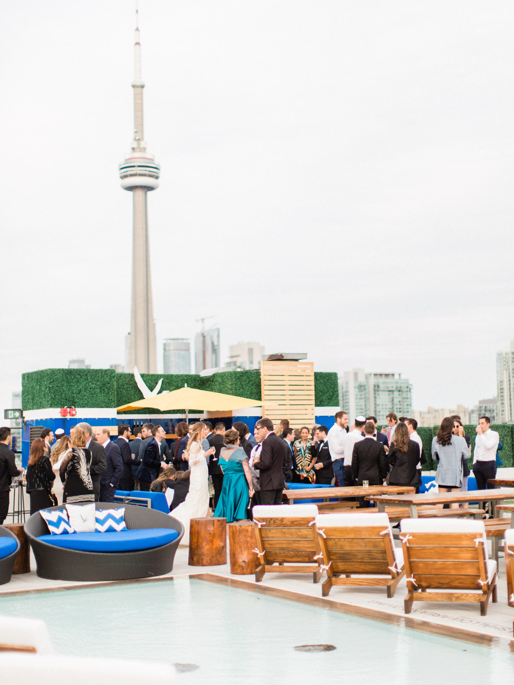 -	Candid wedding photography of guests enjoying the reception at an outdoor summer wedding in Toronto.  Captured by Toronto wedding photographer Corynn Fowler Photography.