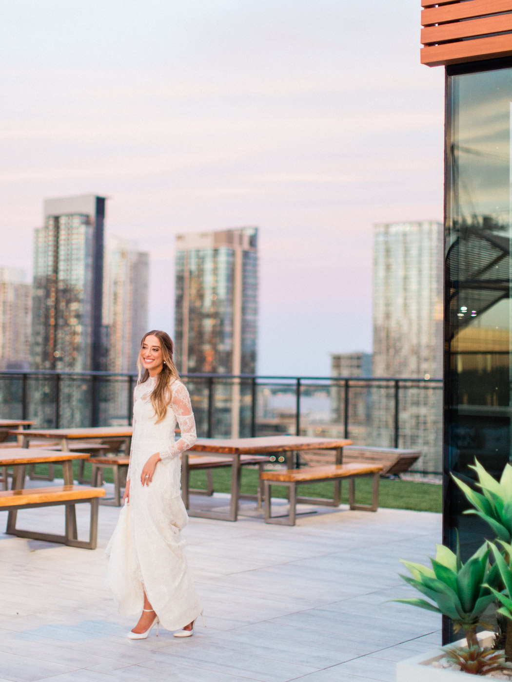 -	Candid natural portrait of bride and groom at sunset. Traditional Sunday Jewish wedding.  Captured by downtown Toronto wedding photographer Corynn Fowler Photography.