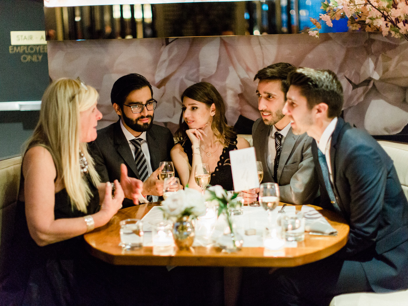 -Candid wedding photography of guests enjoying the reception at an outdoor summer wedding in Toronto.  Captured by Toronto wedding photographer Corynn Fowler Photography.