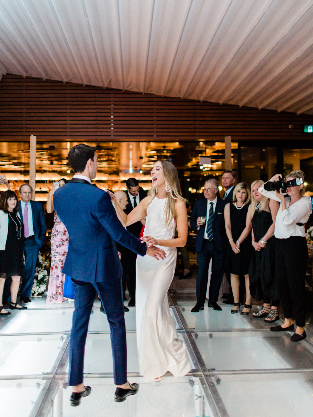 -classic candid photo of the first dance between bride and the groom at their Jewish wedding.  Captured by Toronto wedding photographer Corynn Fowler Photography.