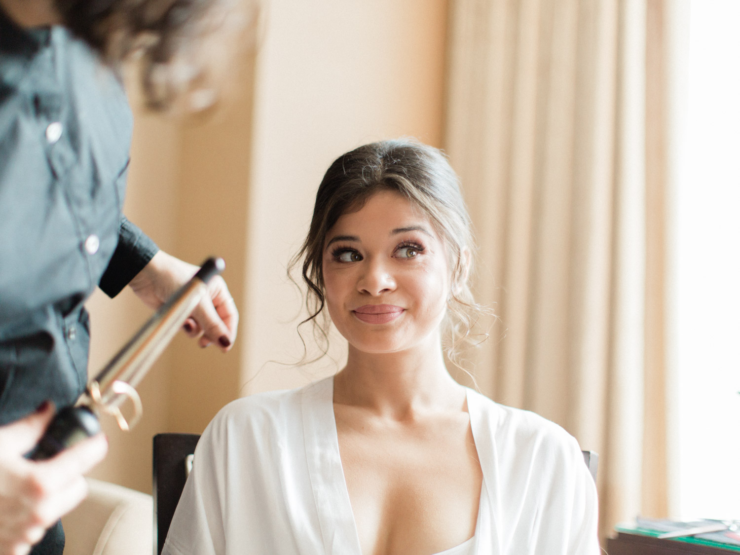 -	Natural, candid photograph of bridesmaids and bride getting ready for a winter wedding at Ritz Carlton in Toronto.  Captured by Toronto wedding photographer Corynn Fowler Photography.