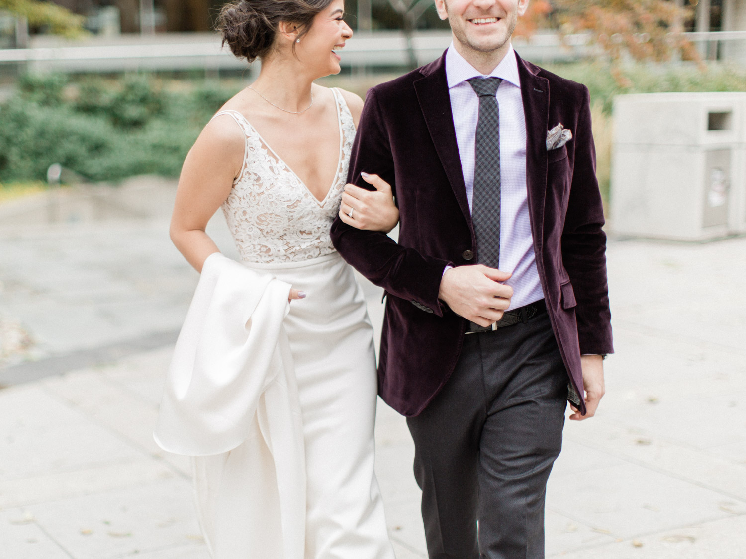 -	candid photograph of bride and groom laughing while posing for wedding photographs in Downtown Toronto.  Captured by Toronto wedding photographer Corynn Fowler Photography.