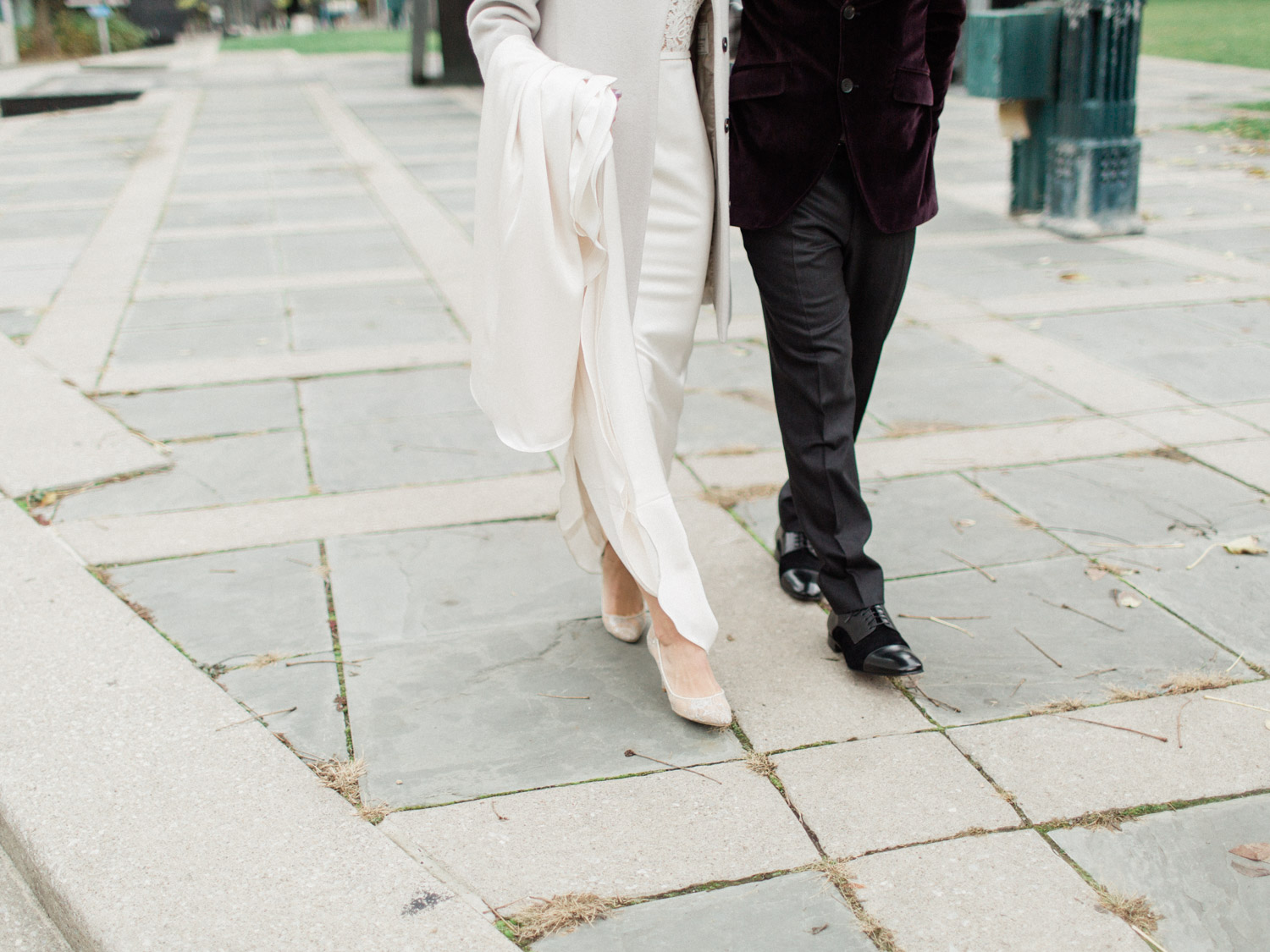 candid photograph of bride and groom laughing while posing for wedding photographs in Downtown Toronto.  Captured by Toronto wedding photographer Corynn Fowler Photography.