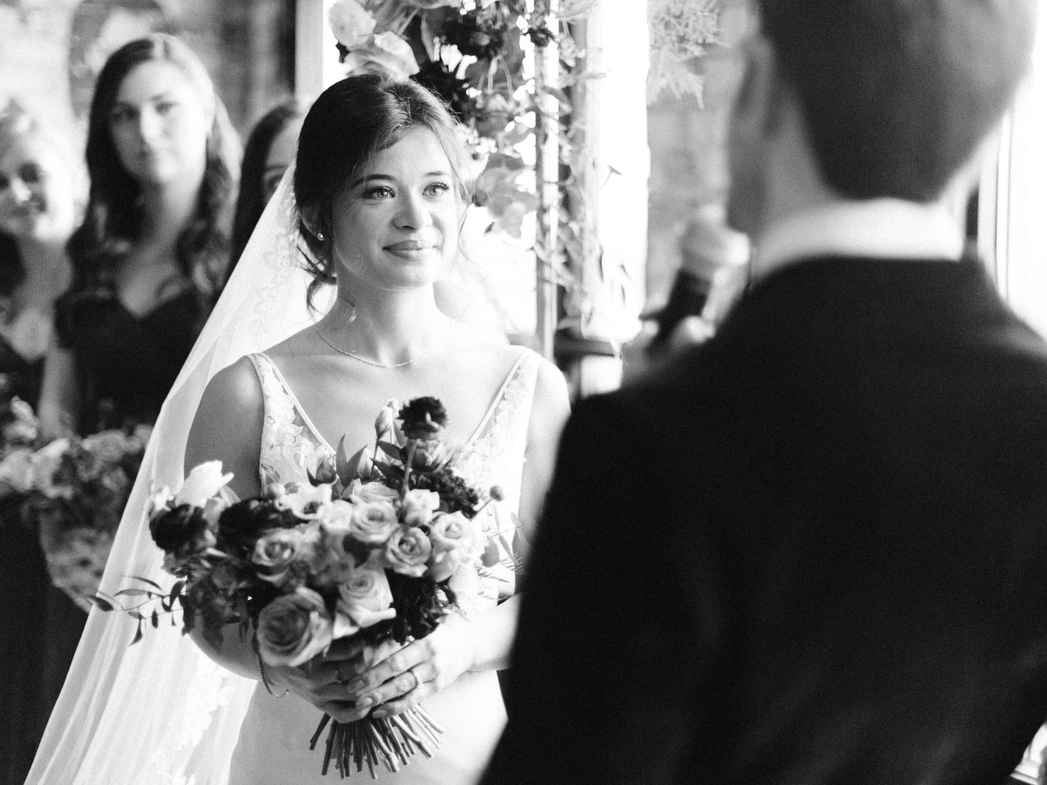 Candid, emotional photograph of indoor winter wedding ceremony at The Burroughes venue in Toronto.  Captured by Toronto wedding photographer Corynn Fowler Photography.