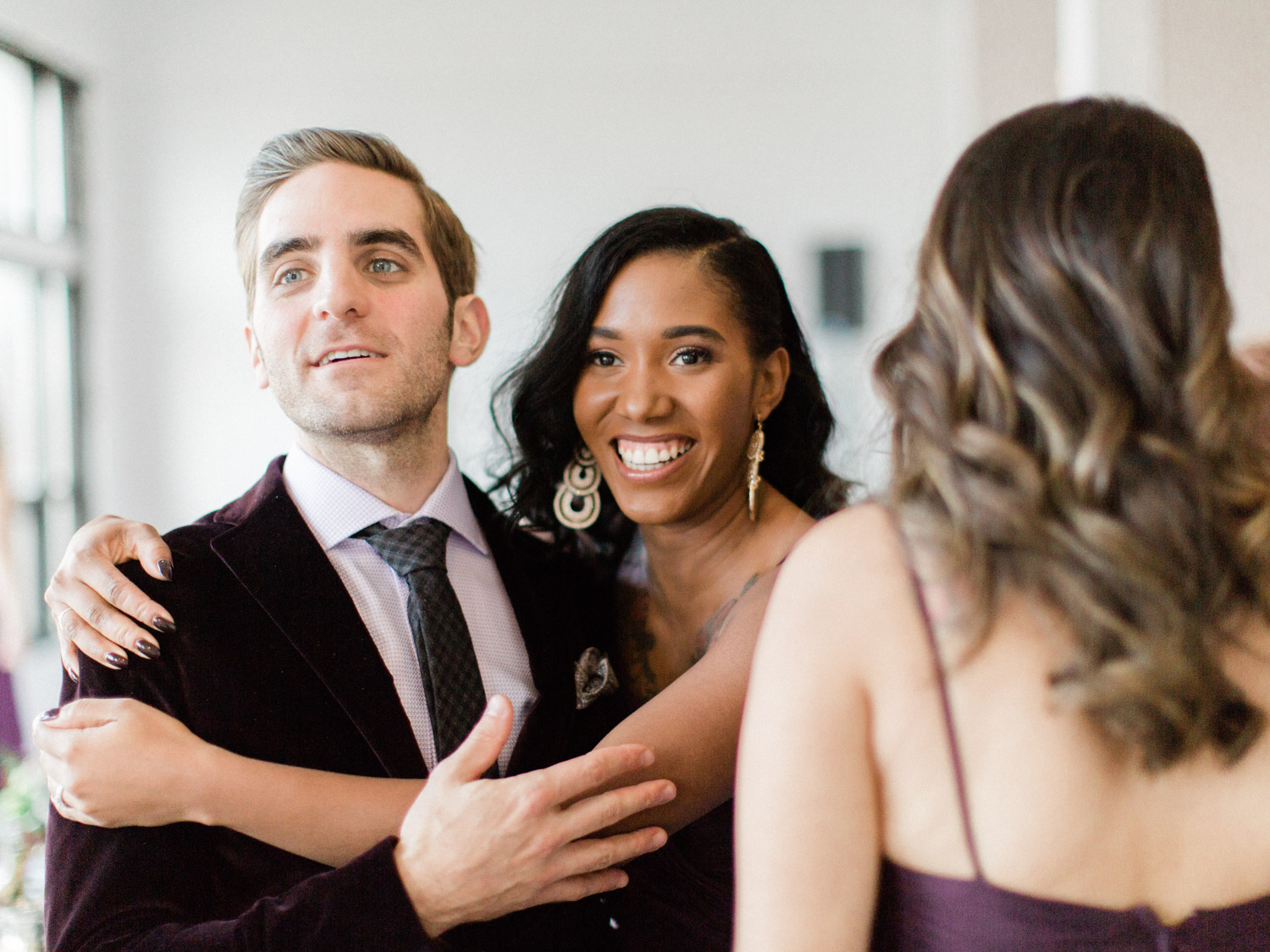 -	Candid wedding photograph of guests, bride and groom enjoying the reception at Italian wedding at The Burroughes.  Captured by Toronto wedding photographer Corynn Fowler Photography.