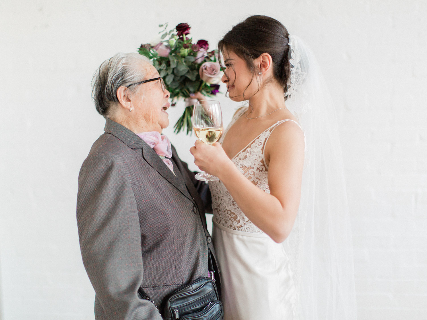 Candid emotional wedding photograph of the bride and her grandmother. Captured by Toronto wedding photographer Corynn Fowler Photography