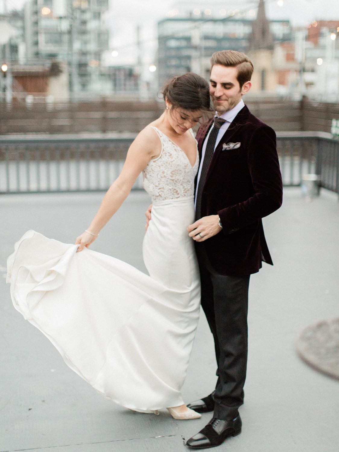 candid and romantic photograph of the bride and groom dancing on the rooftop of the Burroughes. Captured by Toronto wedding photographer Corynn Fowler Photography