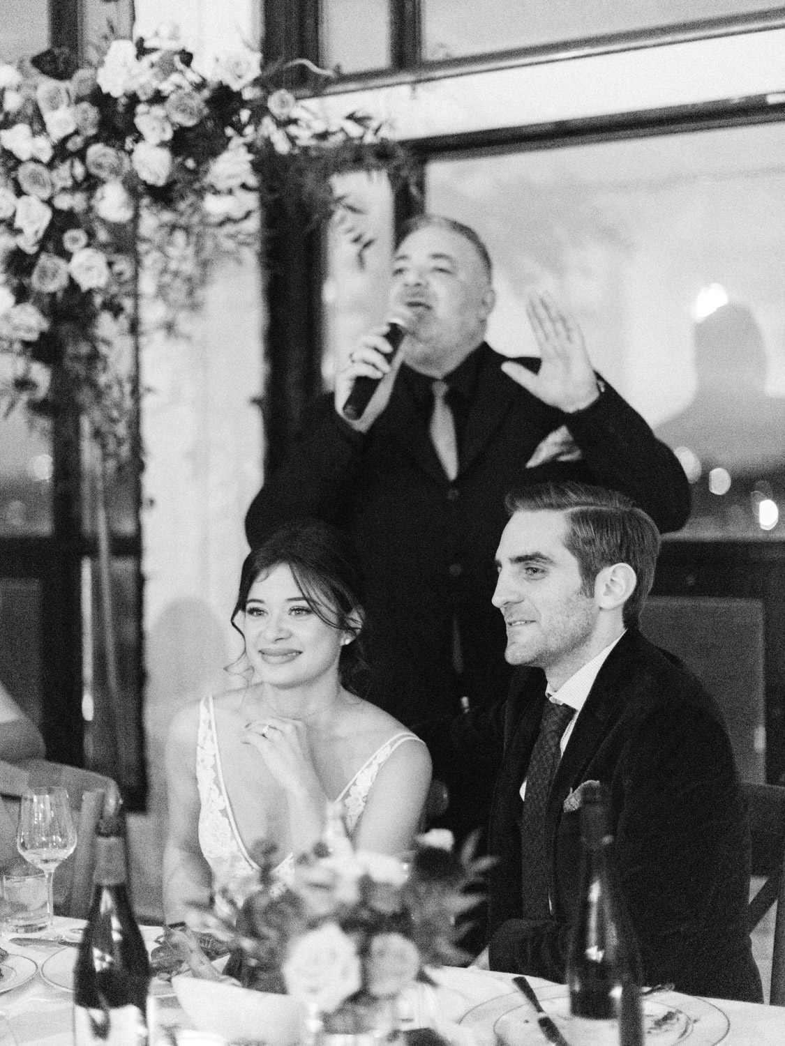 Candid wedding photograph of guests, bride and groom enjoying the reception at Italian wedding at The Burroughes.  Captured by Toronto wedding photographer Corynn Fowler Photography.