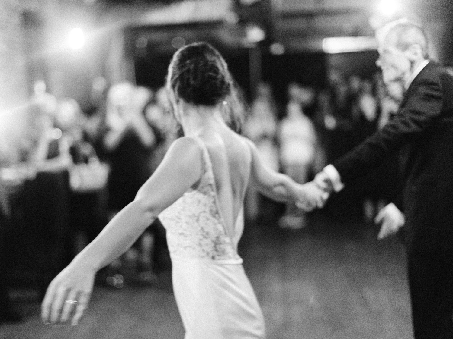 Emotional natural father daughter dance photograph from intimate Italian wedding  at The Burroughes.  Captured by Toronto wedding photographer Corynn Fowler Photography.