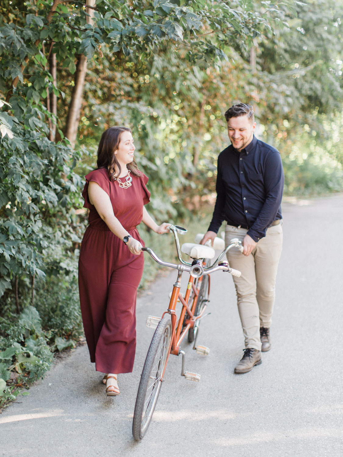 sunrise engagement session at Trinity Bellwoods park with a tandem bicycle