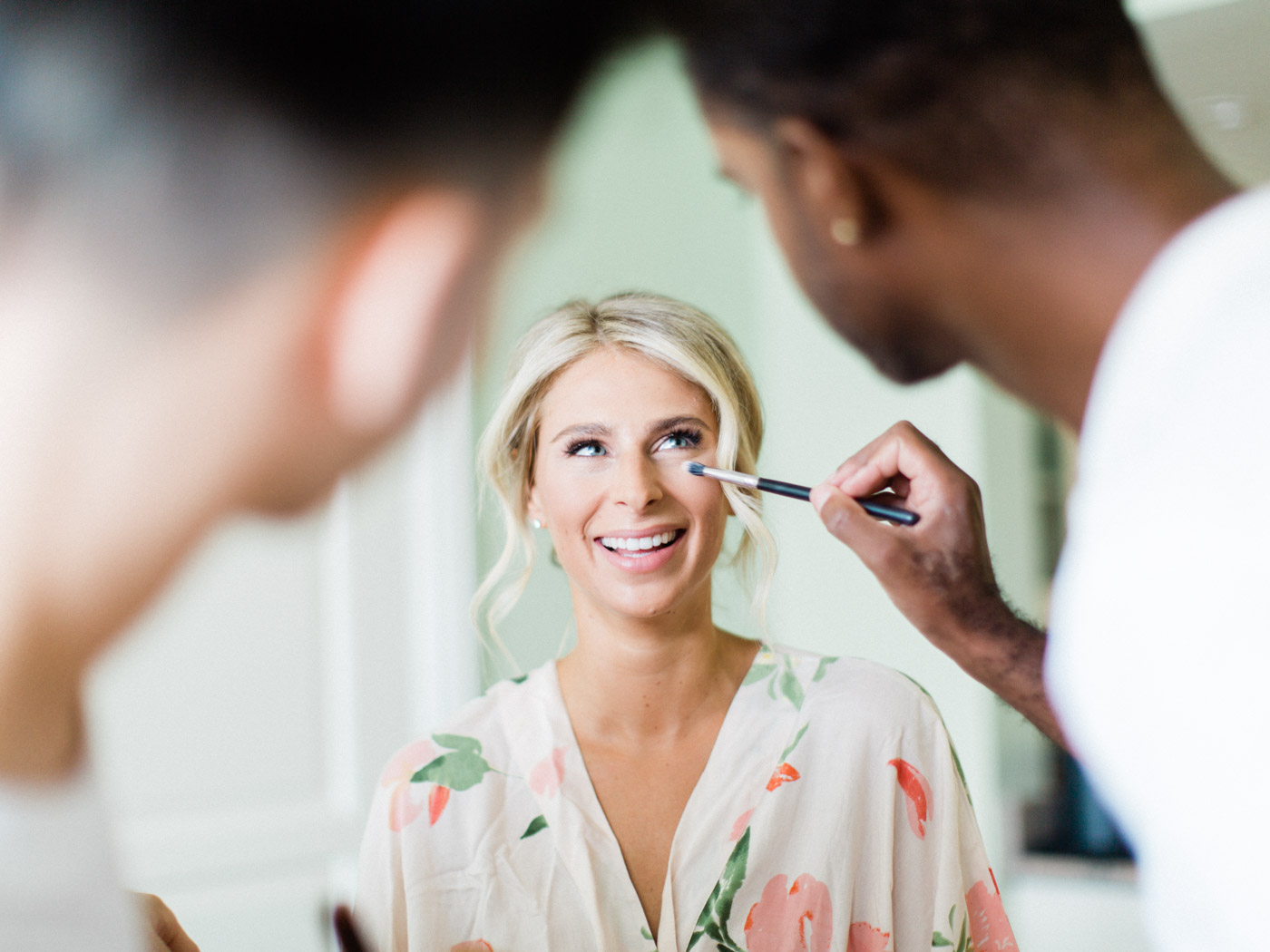 Candid, natural photograph of bride and bridesmaids getting ready for an outdoor summer wedding at J.W. Marriott Rosseau, Muskoka.  Captured by Muskoka wedding photographer Corynn Fowler Photography.