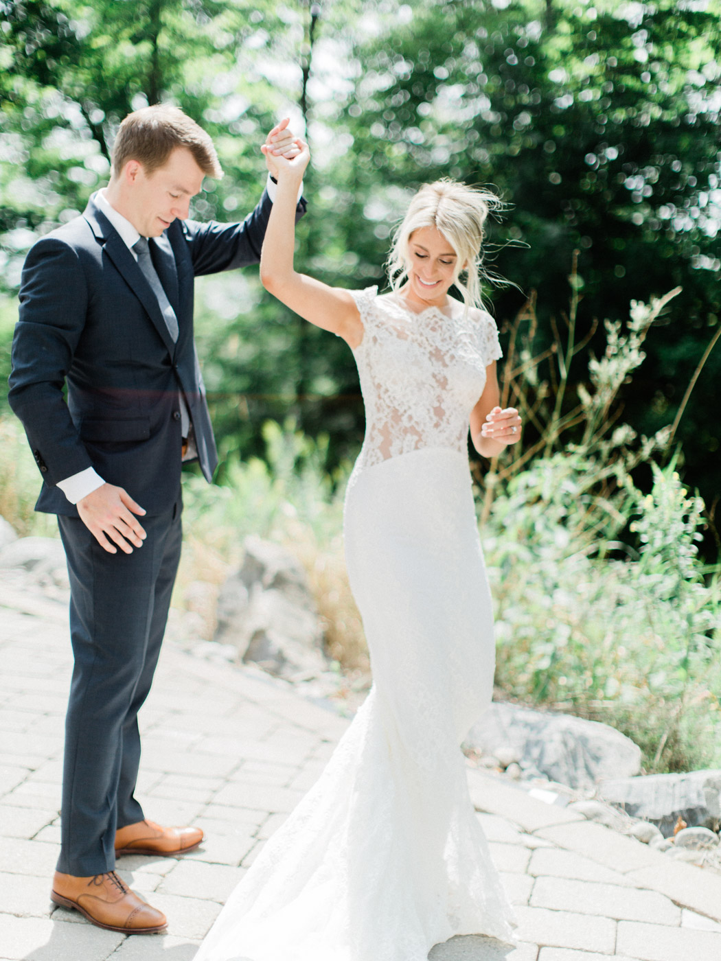 Romantic, happy, emotional first look at summer wedding in Muskoka at J.W. Marriott Rosseau.  Captured by Muskoka wedding photographer Corynn Fowler Photography.