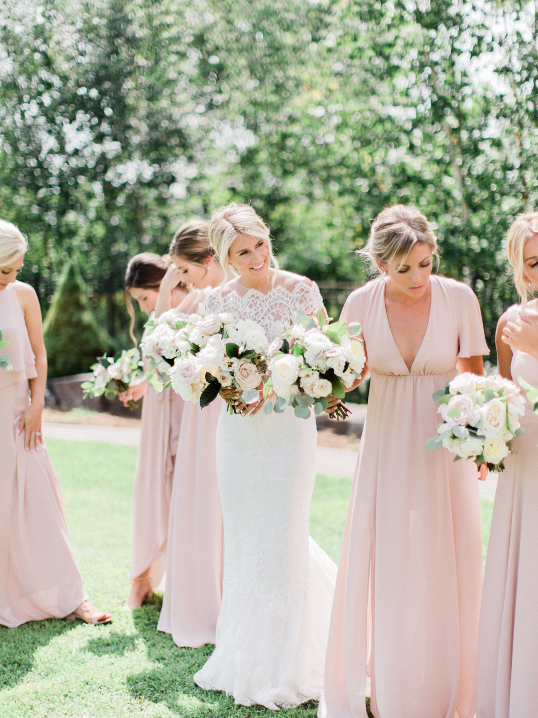 -	Candid and natural posing idea for the bridal parties.  Captured at summer wedding in Muskoka by wedding photographer Corynn Fowler Photography.