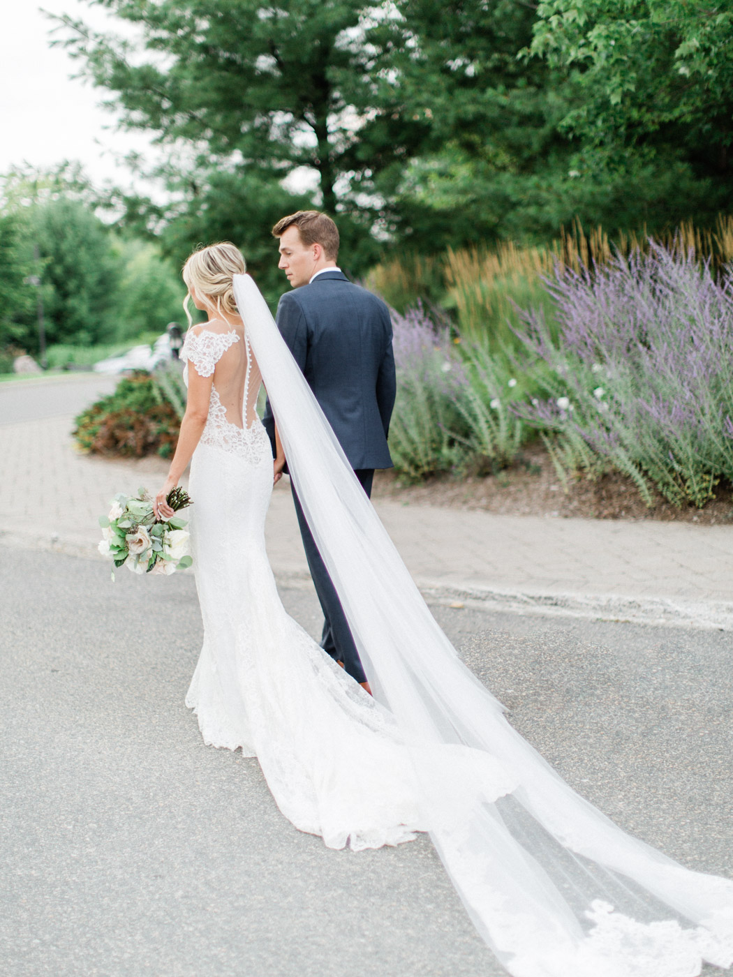 Classic candid portrait of  bride and groom at outdoor summer Muskoka wedding.  Captured at the J.W. Marriott Rosseau by wedding photographer Corynn Fowler Photography.