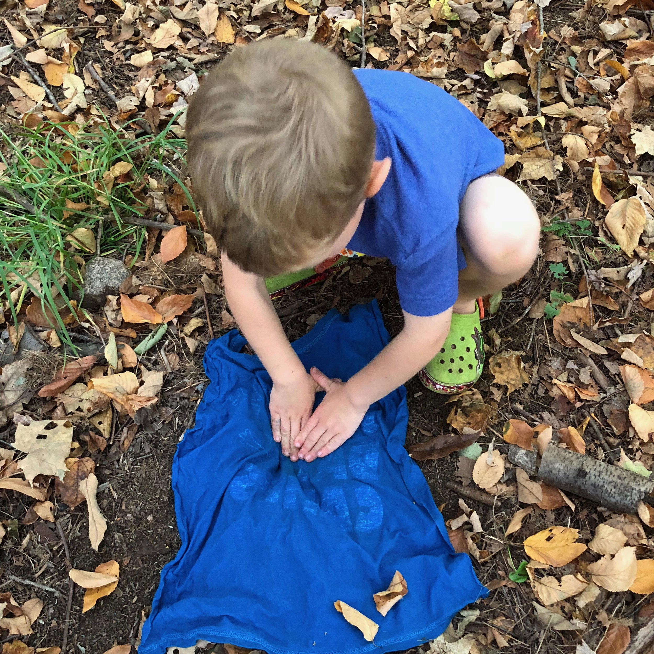 We laid down cotton t-shirts to keep the dirt out of our clay. Native Americans probably would have formed their pots on wood planks or hides.