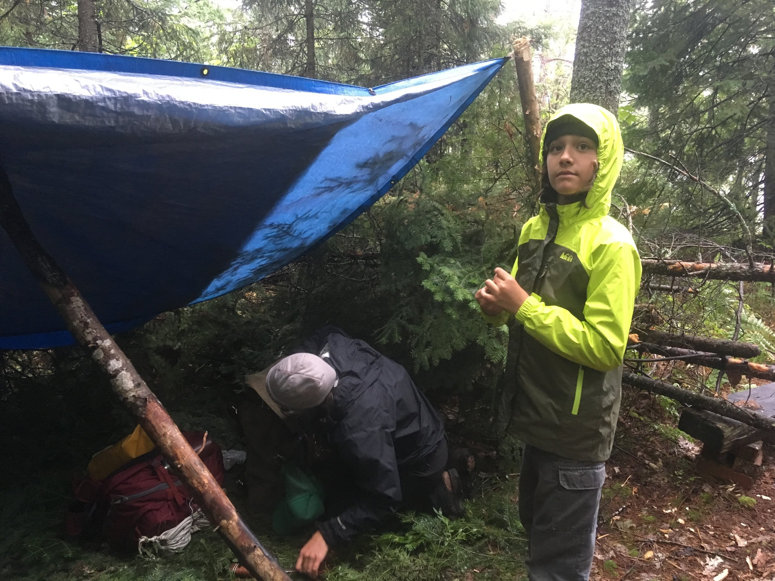 Taking down our camp in the rain