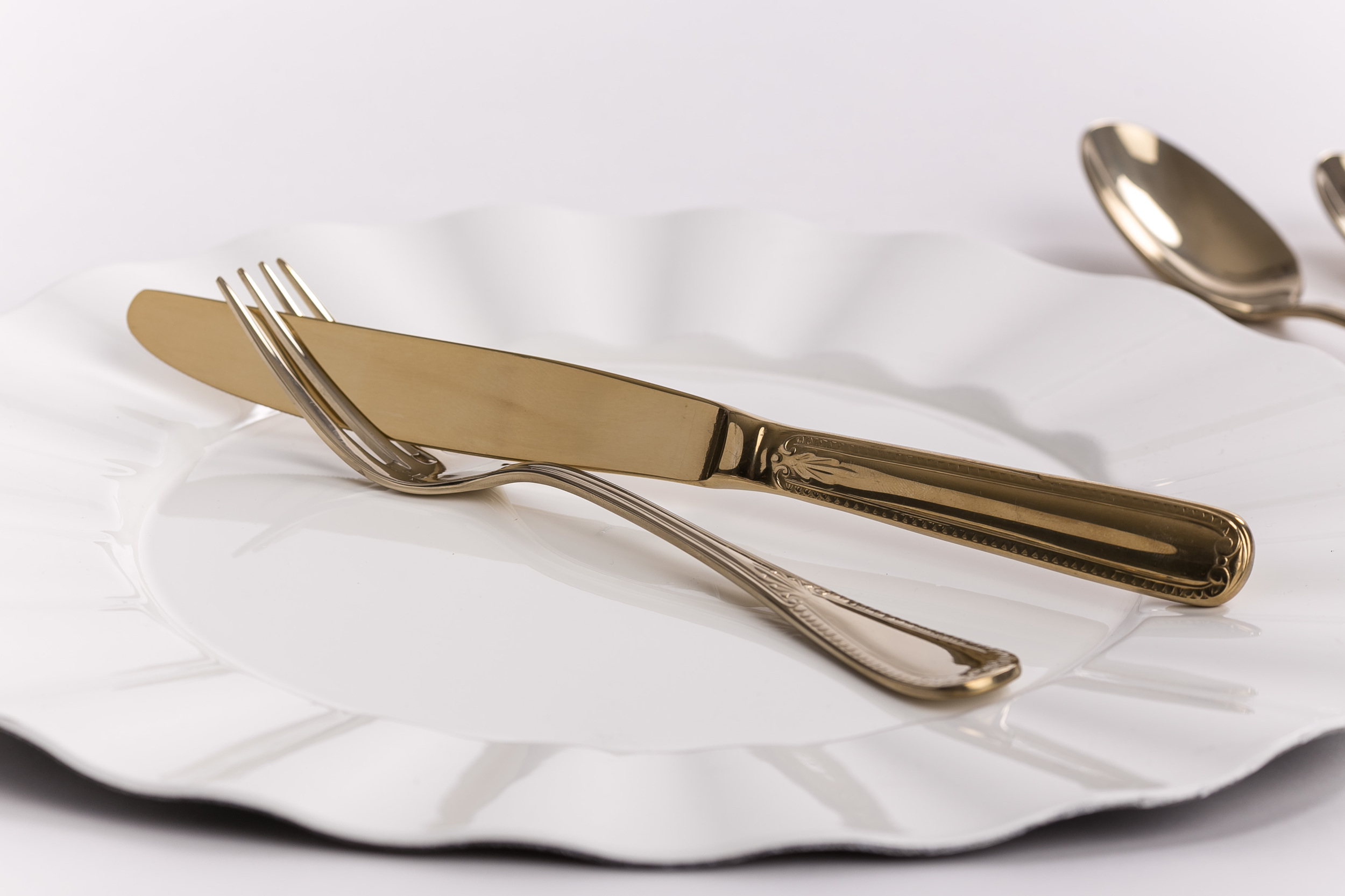 Accentuate your décor with a touch of Gold. Contact us for more information about our   Gold Flatware  .