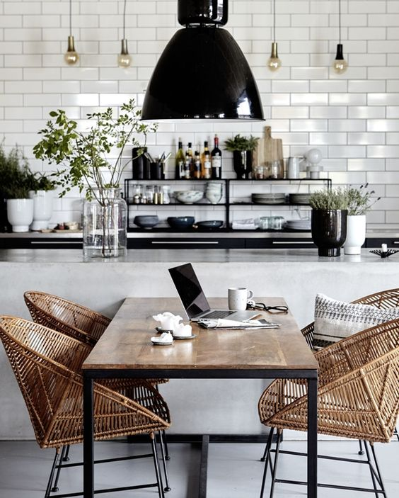 This second example again reveals that rattan pairs so well with classic elements, like the white subway in the kitchen area. The funky and modern chair shape pumps up the rattan impact. With an looser open weave, rattan helps these chairs to feel light, airy and sculptural.