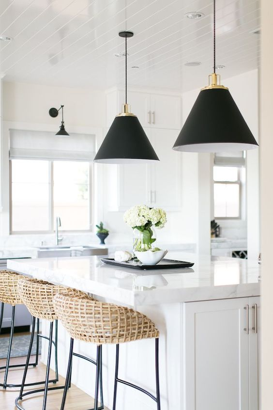 This image illustrates one of my favorite design equations: rattan + black + white. Can you say chic? This kitchen is fresh, but so much more interesting than just a safe all white kitchen. The rattan stools add a gorgeous layer of earthy texture and add a dash of ecclectic style.