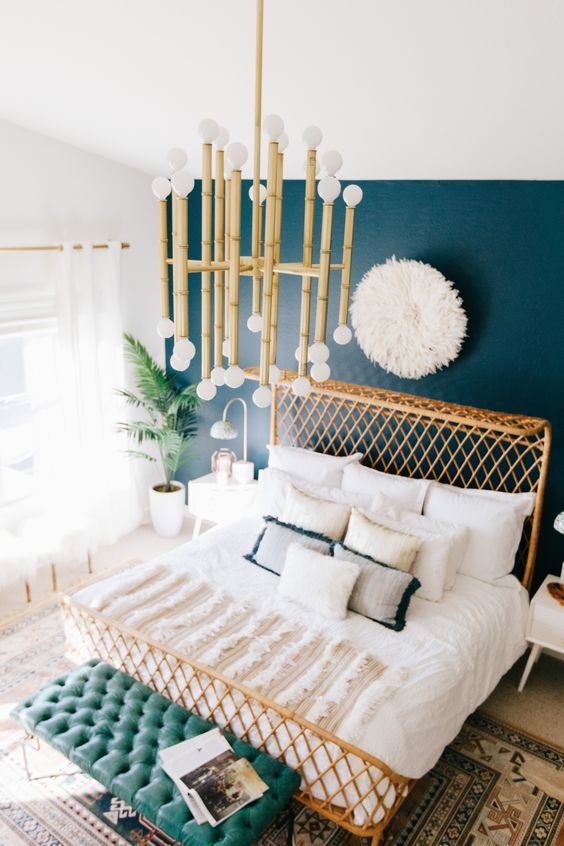 Not a white wall fan? We can still be friends. I included this bedroom to show than rattan plays nicely with color too. This bed pops off the beautiful teal wall!