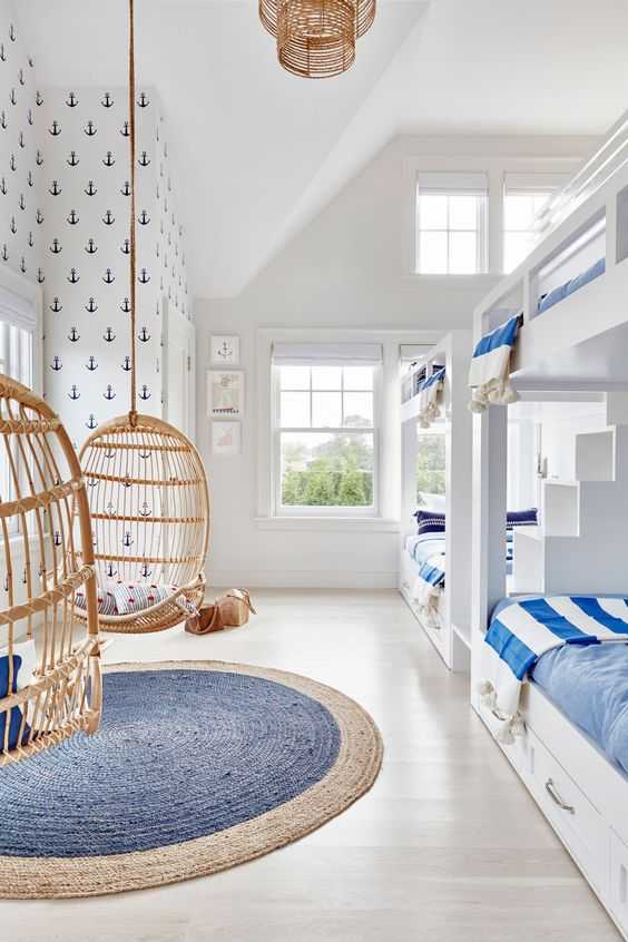 A lot of rattan pieces are so great b/c they come in whimsical and untraditional shapes. Like these hanging chairs in this fresh and nautical bunk room. Cover up the chairs in the photo with your hand - the room is still nice, but just plain. The rattan chairs add the personality!