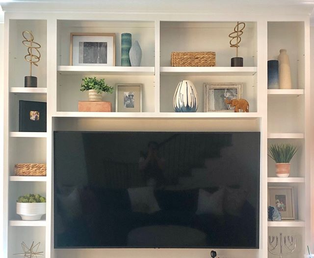 "We all have that ""big black box""... but luckily these newly styled shelves will help distract from it!"