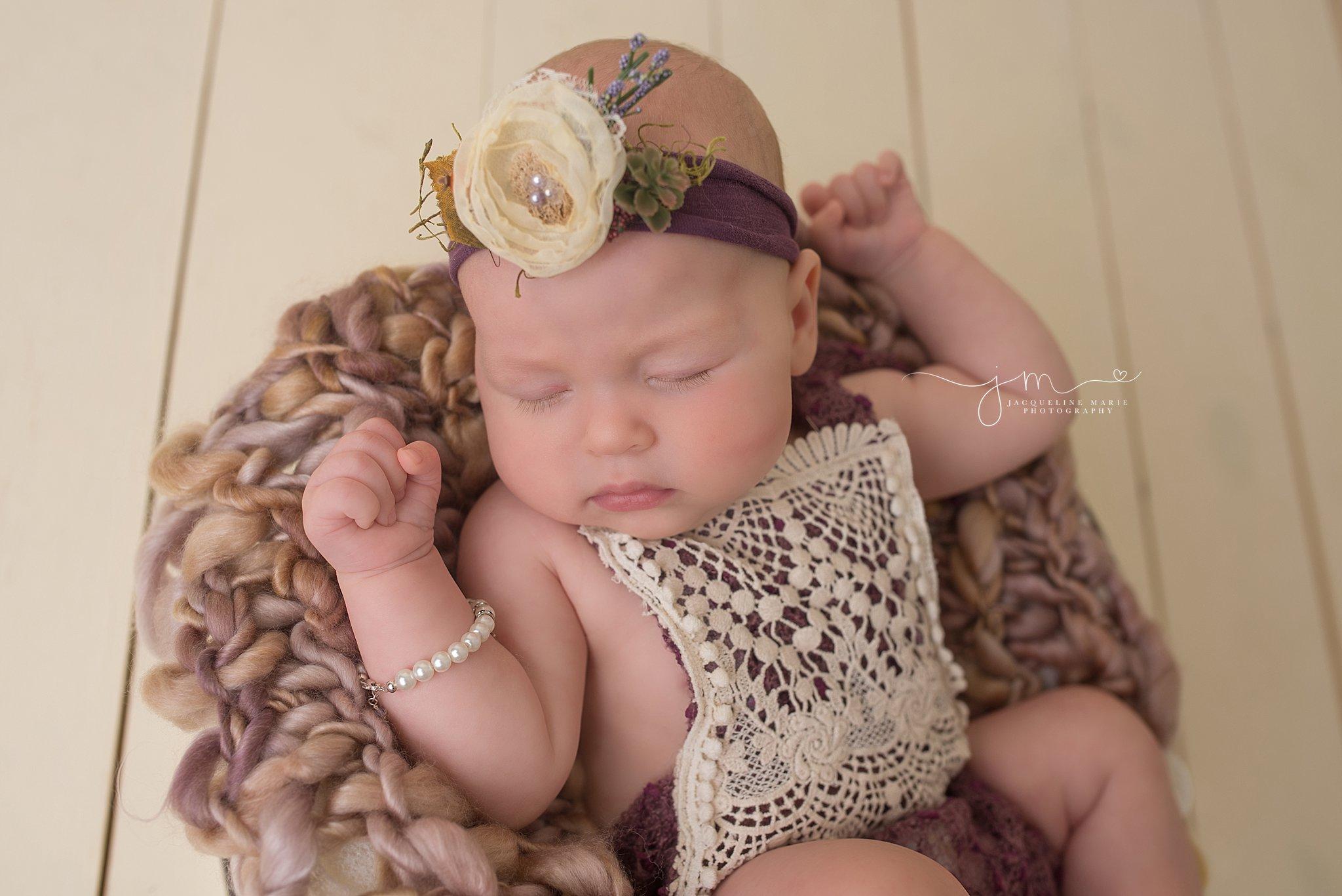 Jacqueline Marie Photography studio in Columbus Ohio features 3 month milestone baby portrait sleeping in white wood bucket