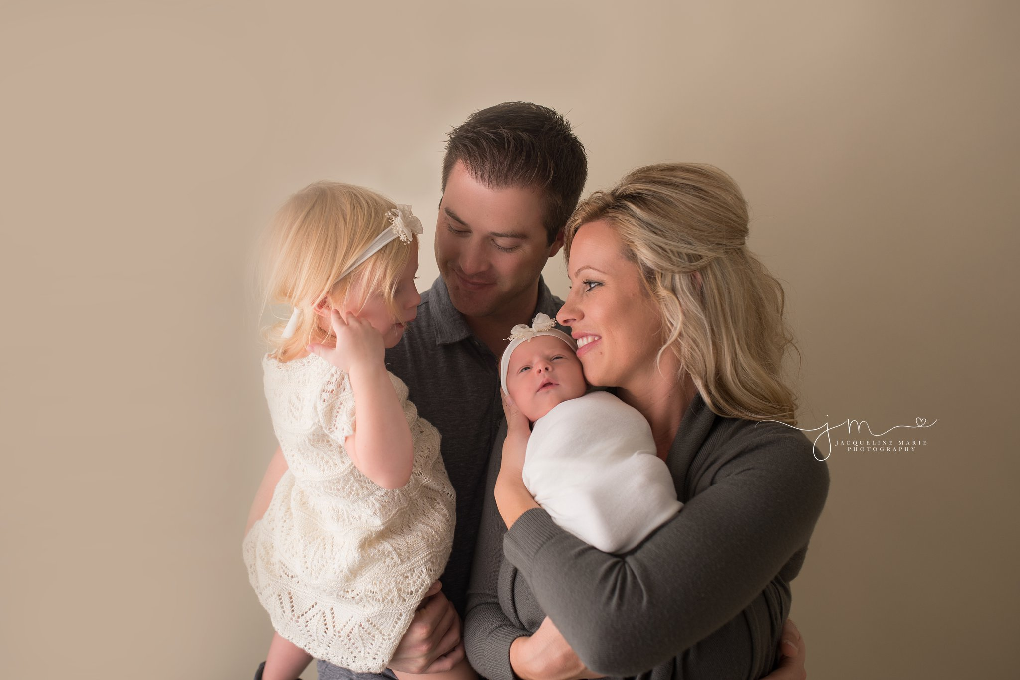 Columbus Ohio newborn photographer features family portrait with newborn baby at Jacqueline Marie Photography studio
