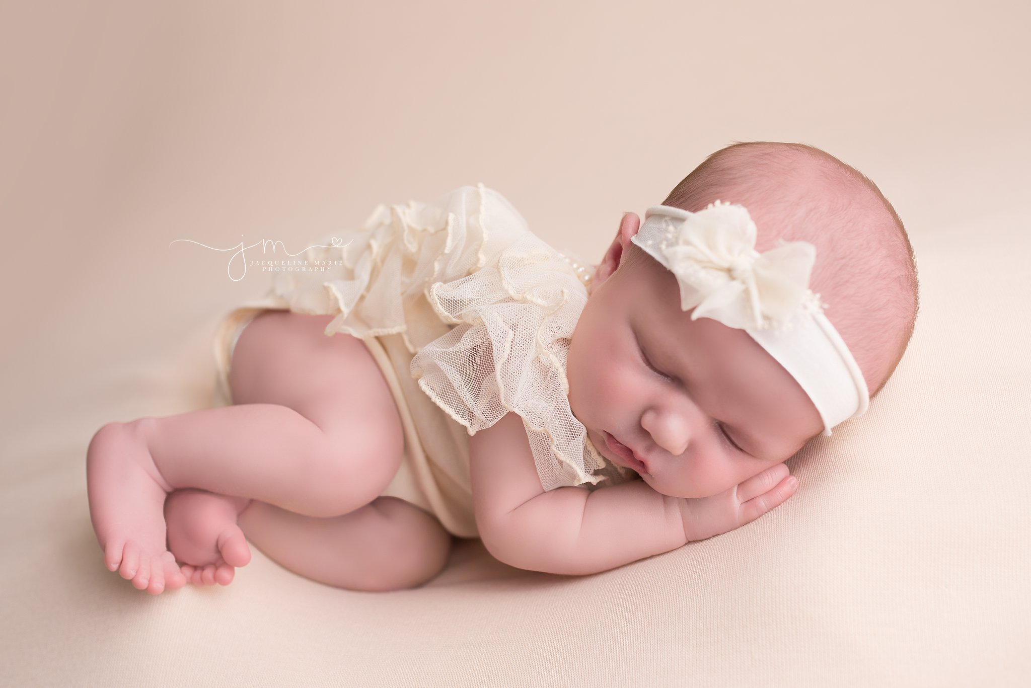Sleeping newborn baby girl portrait features fingers and toes while baby sleeps in Columbus Ohio at Jacqueline Marie Photography