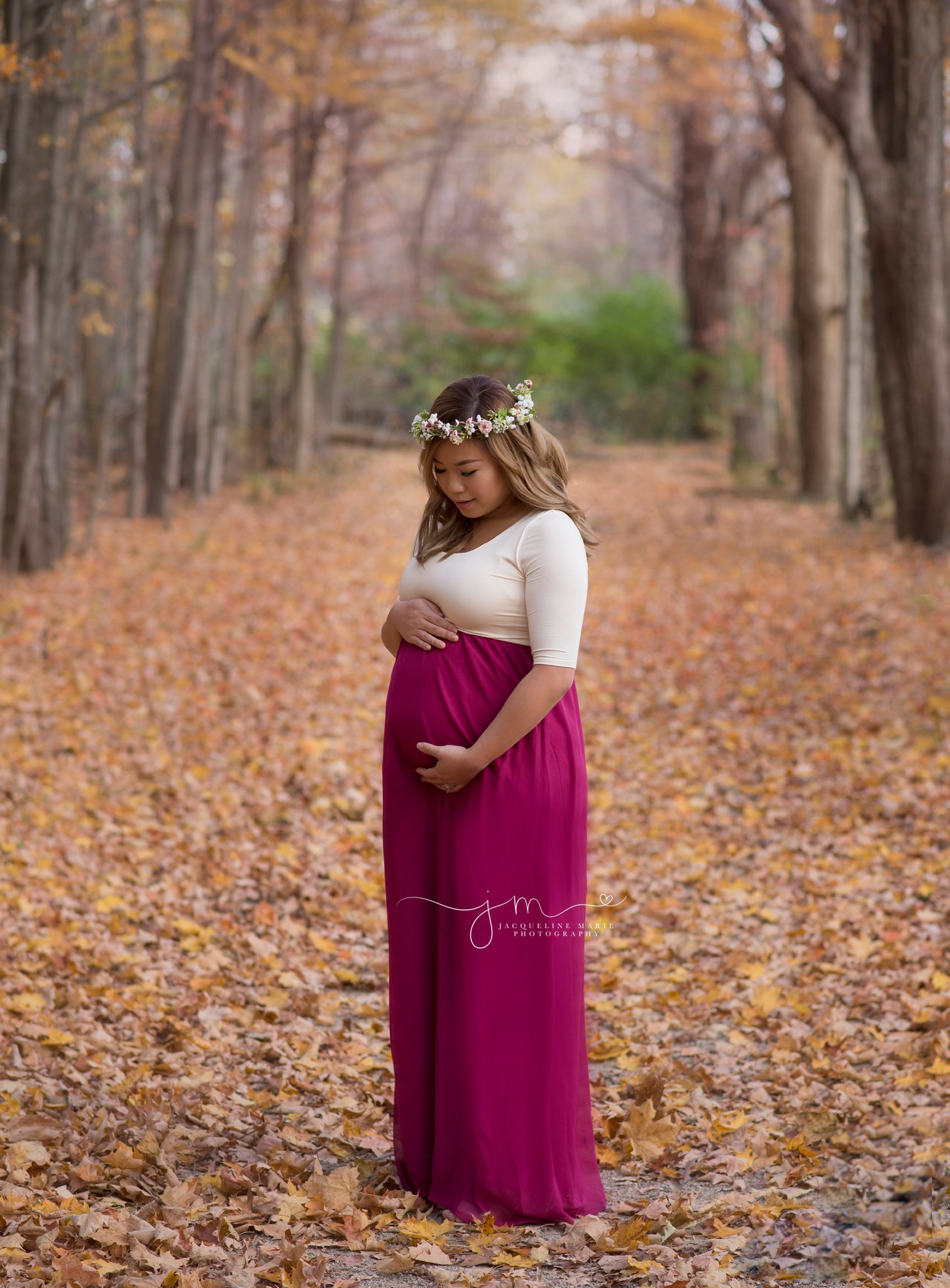 columbus ohio newborn photographer features image of pregnant mother for pregnancy pictures wearing fuchsia pink dress at high banks metro park in lewis center ohio