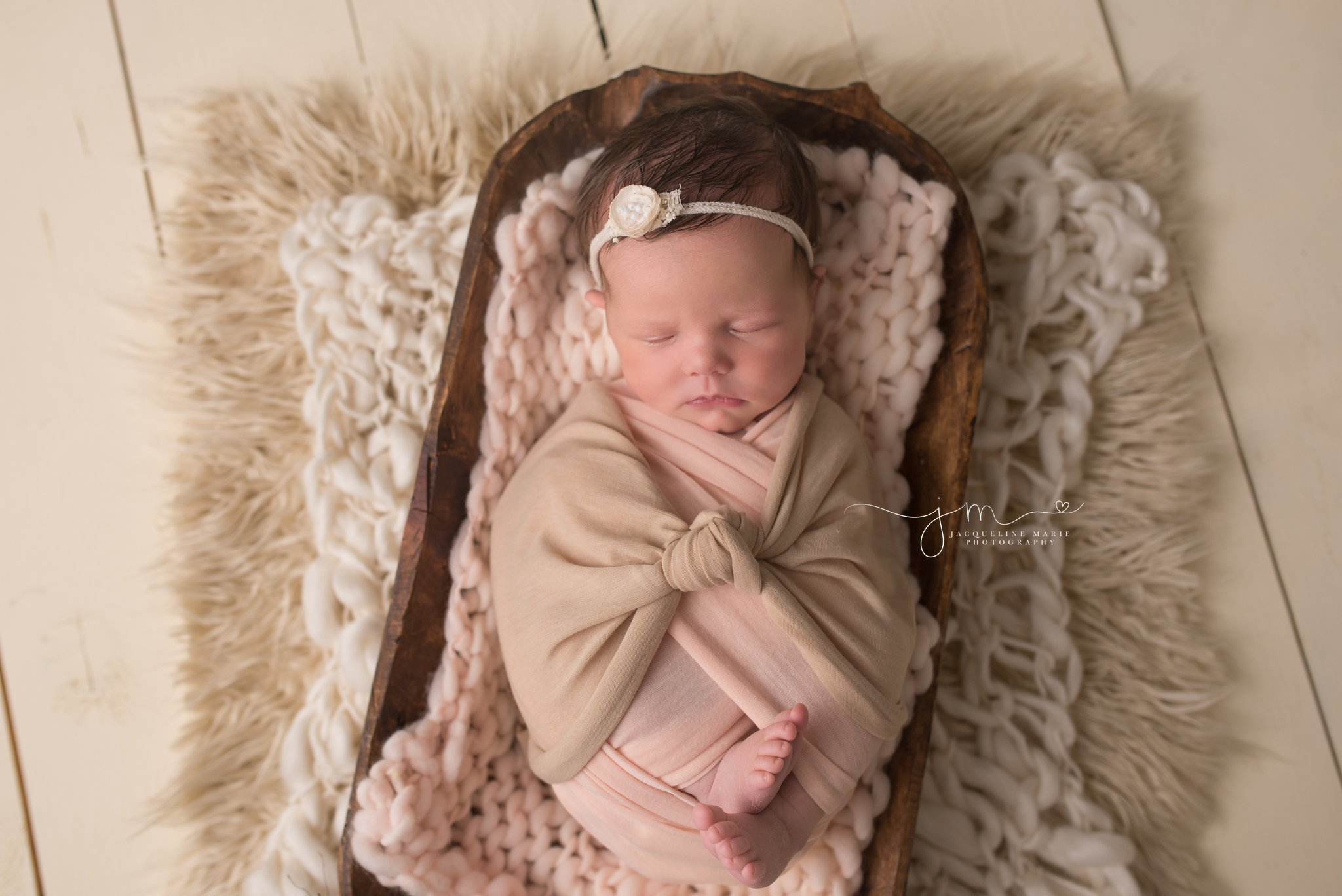 newborn baby sleeps while swaddled in vintage bowl at portrait studio in Columbus-Ohio