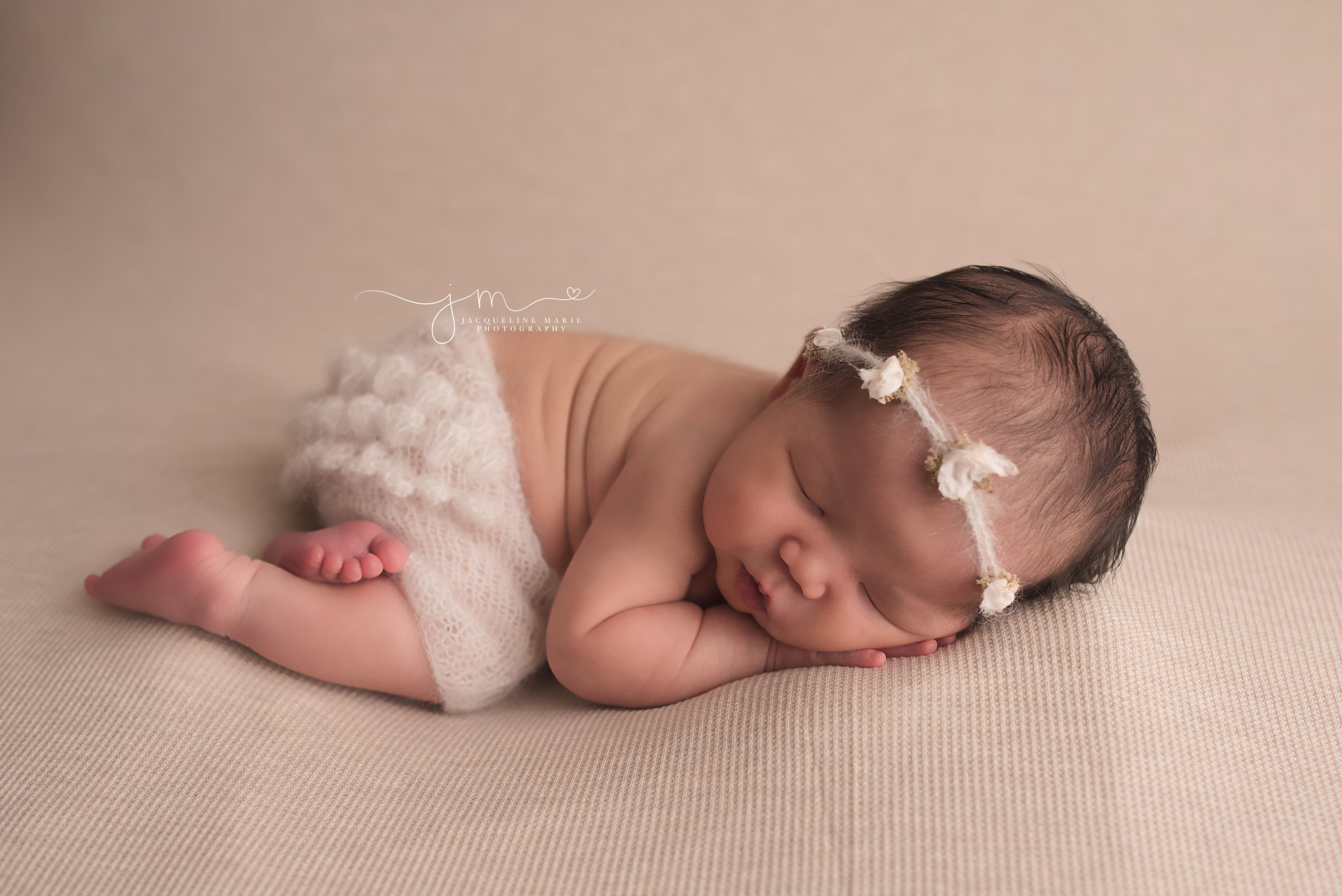 Columbus Ohio 9 day old newborn wears cream ruffle pants for newborn session at Jacqueline Marie Photography studio