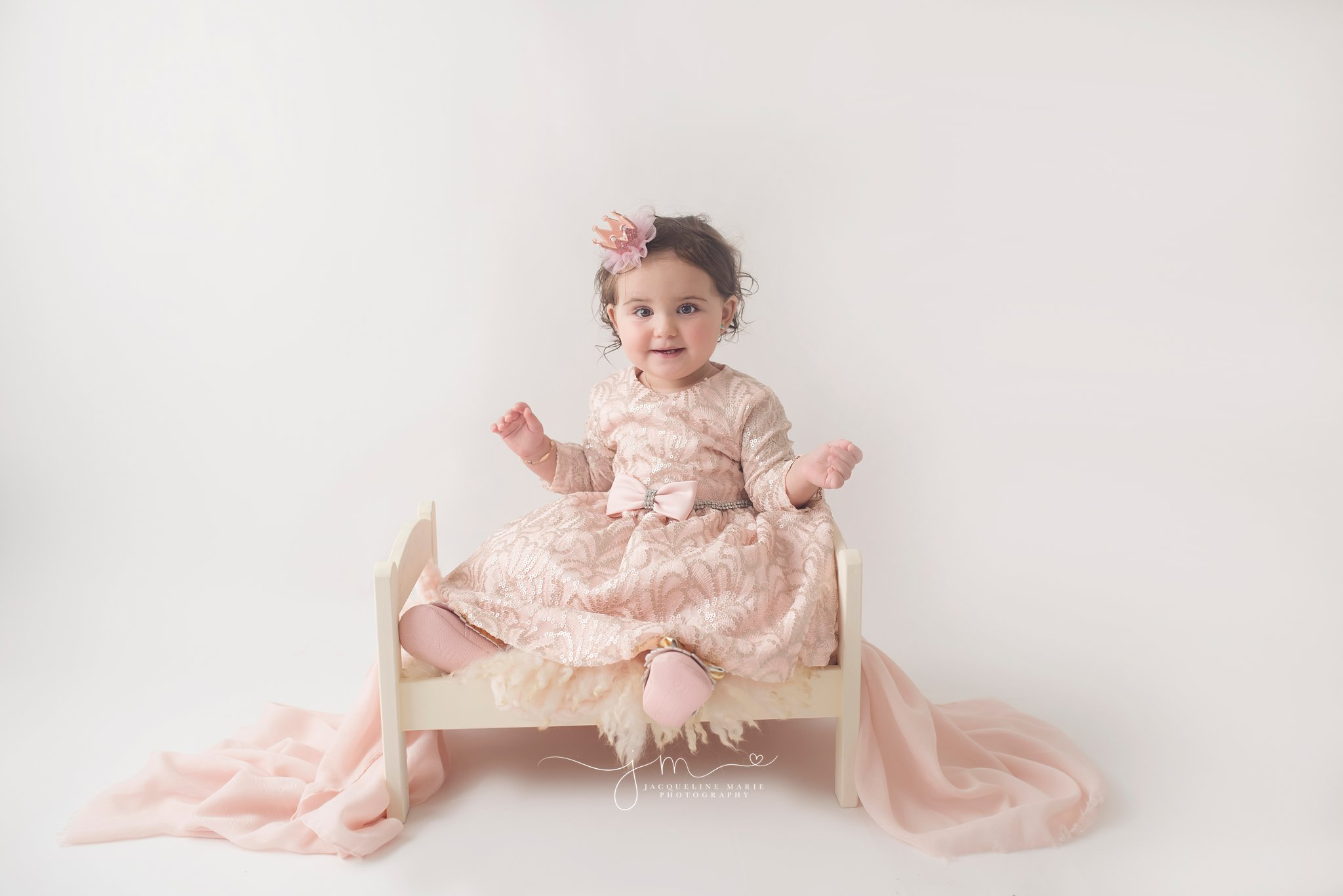 One year old little girl wears pink and silver dress for first birthday pictures in columbus ohio