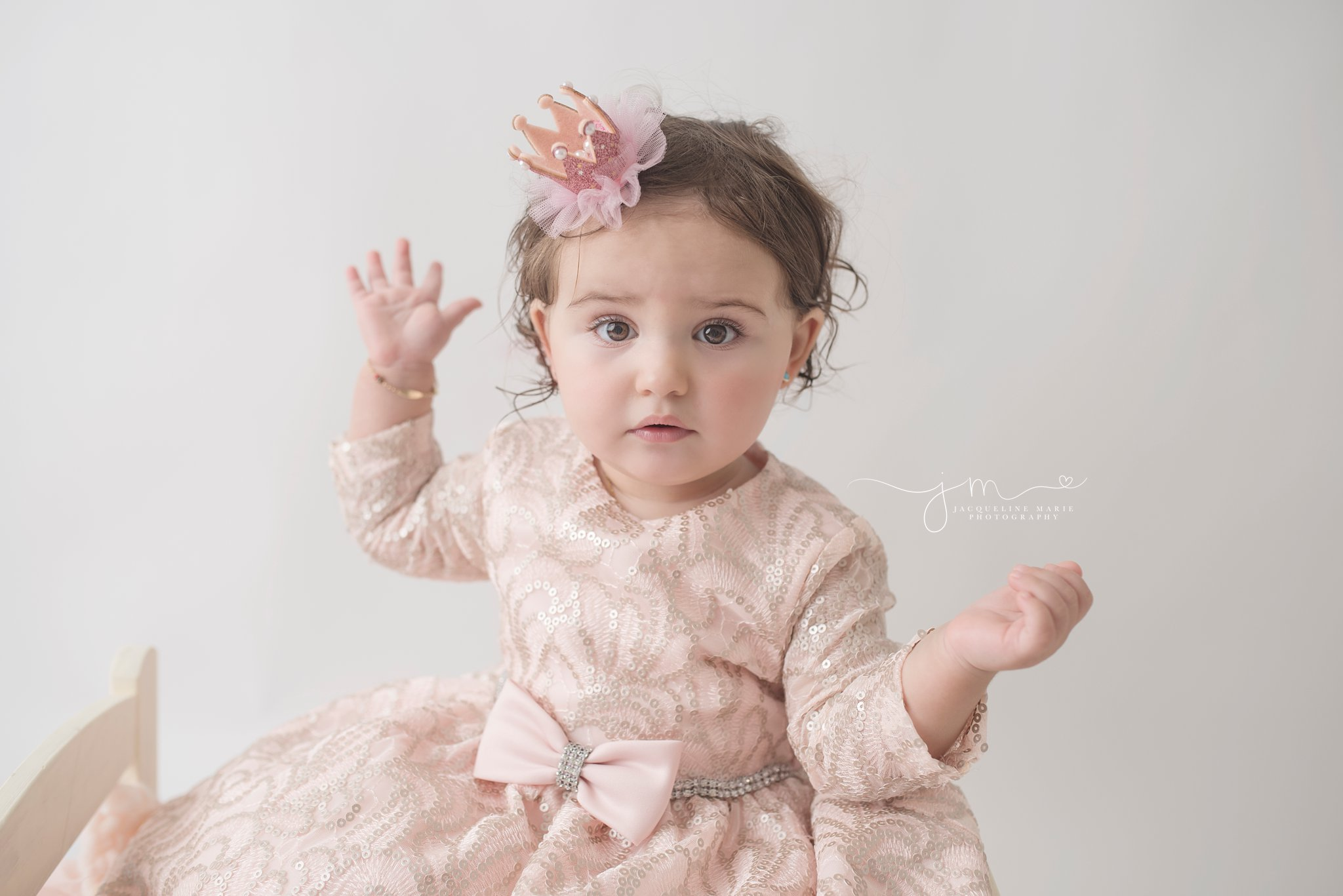first birthday portrait features baby girl wearing pink crown for birthday pictures in columbus ohio