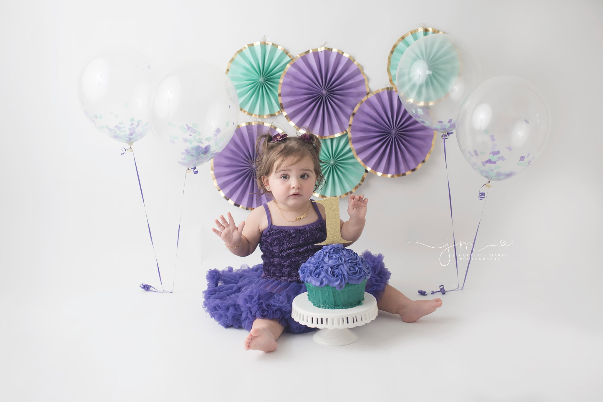first birthday cake smash pictures features purple and turquoise cake with confetti balloons in columbus ohio