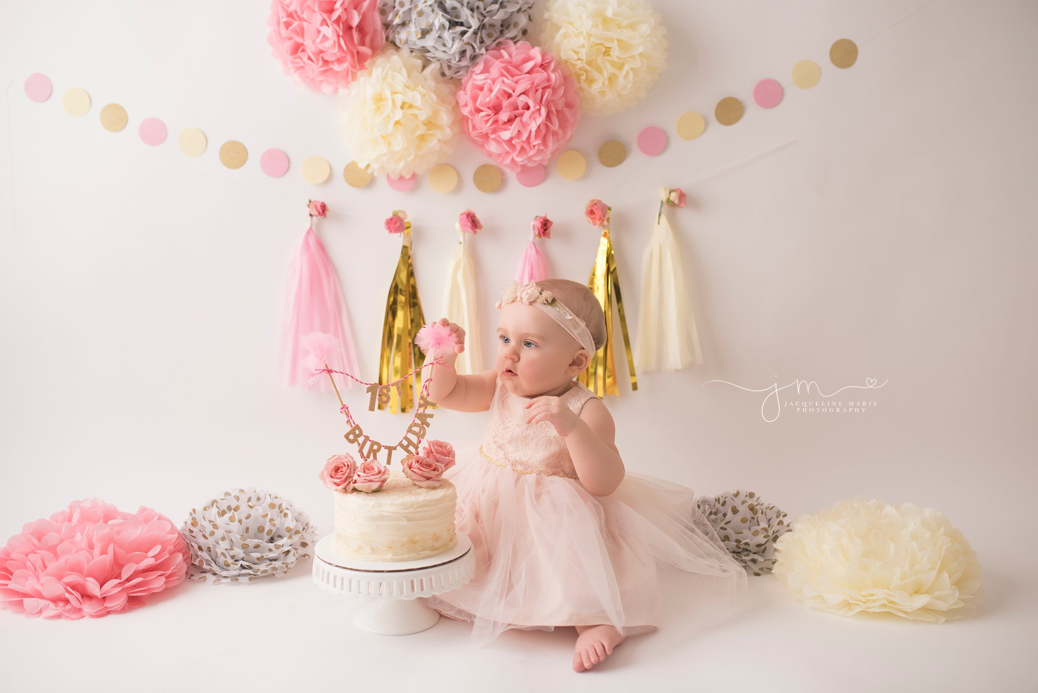 columbus ohio baby photographer features portrait with baby girl eating cake