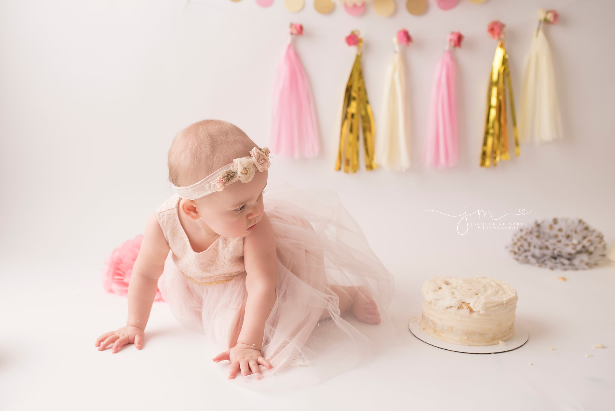 first birthday photographer features baby wearing pink and gold dress in columbus ohio