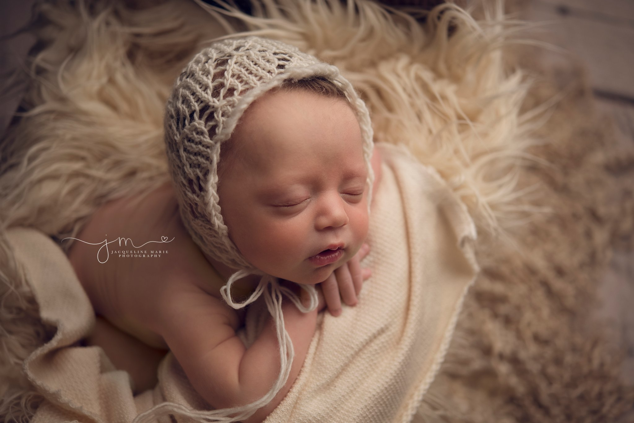 columbus ohio newborn photographer captures newborn baby girl in cream bonnet for newborn mentoring session with Photograpy by axis design in toccoa georgia
