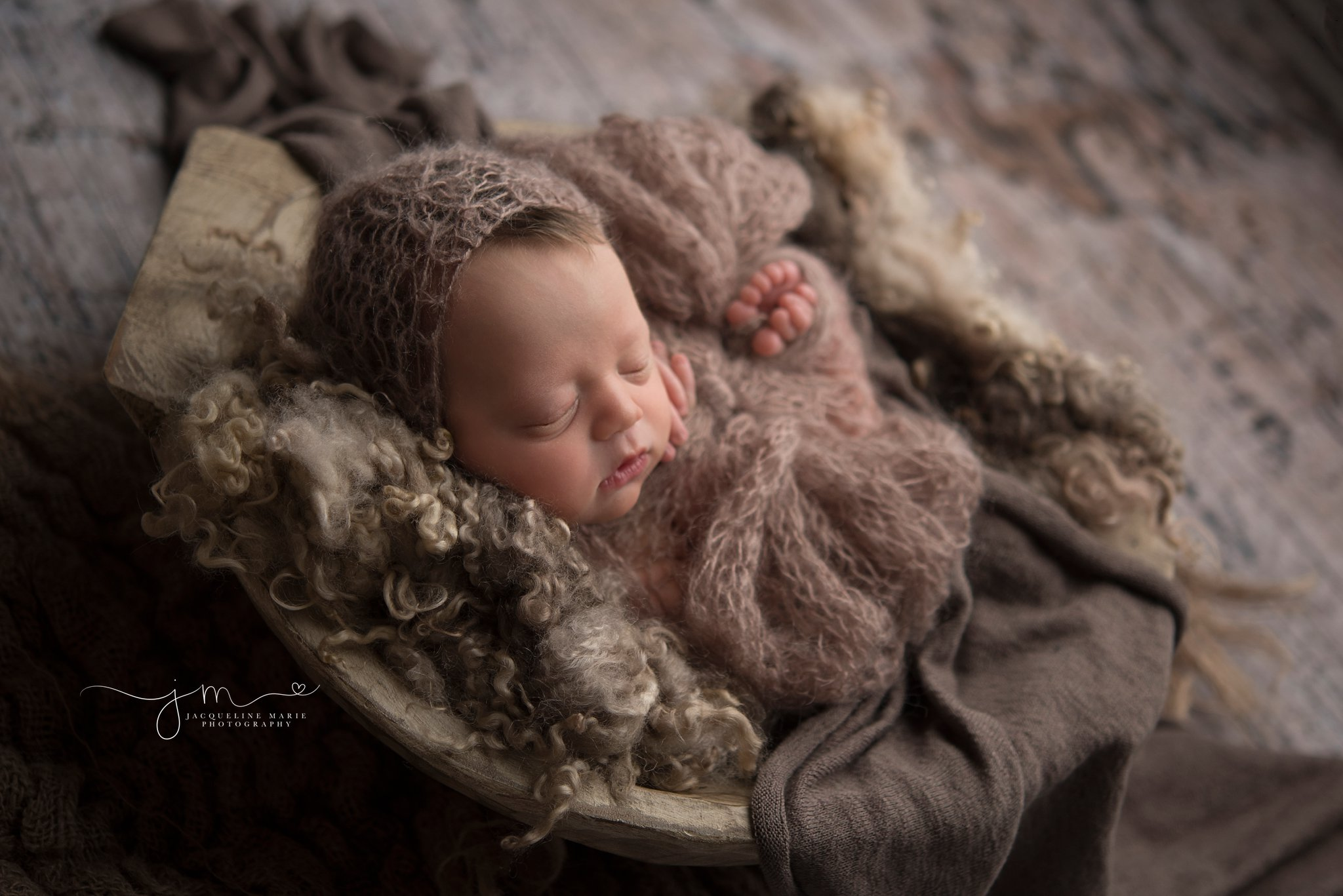 newborn baby girl wears brown bonnet for photography session by columbus ohio newborn photographer