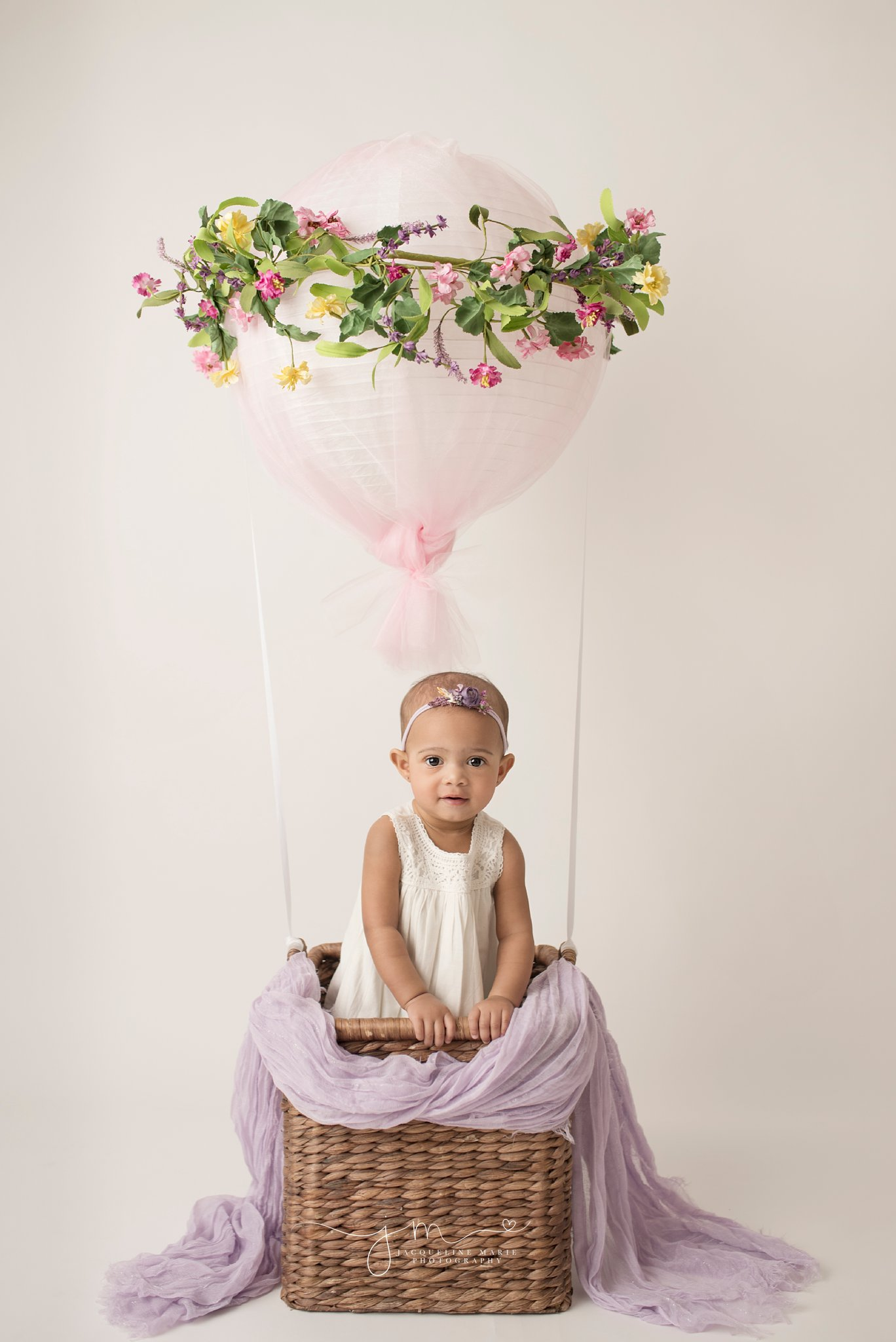 first birthday photographer features baby girl in hot air balloon prop in columbus ohio