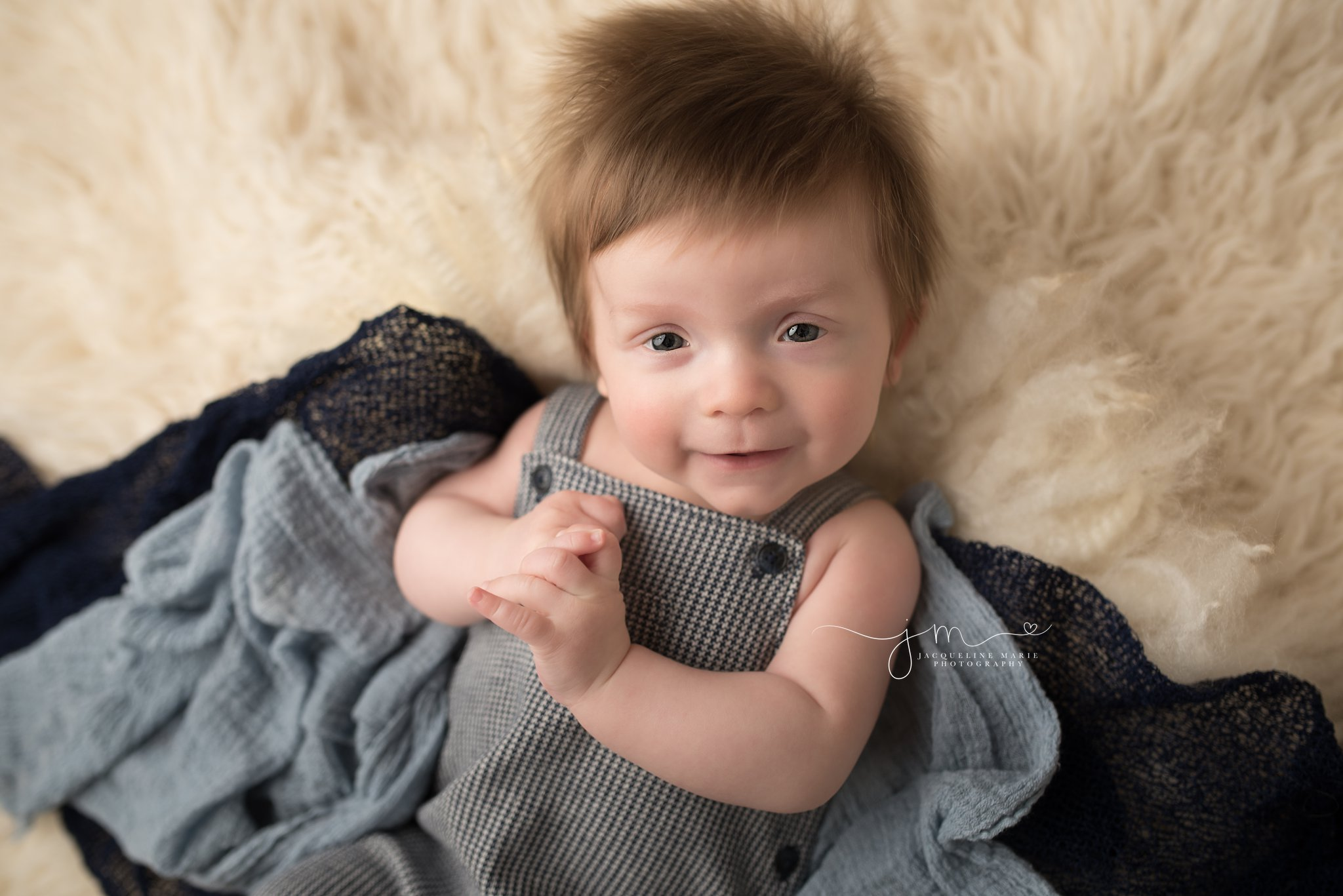 columbus ohio three month old baby boy wears navy blue romper from janie and jack for milestone photography session