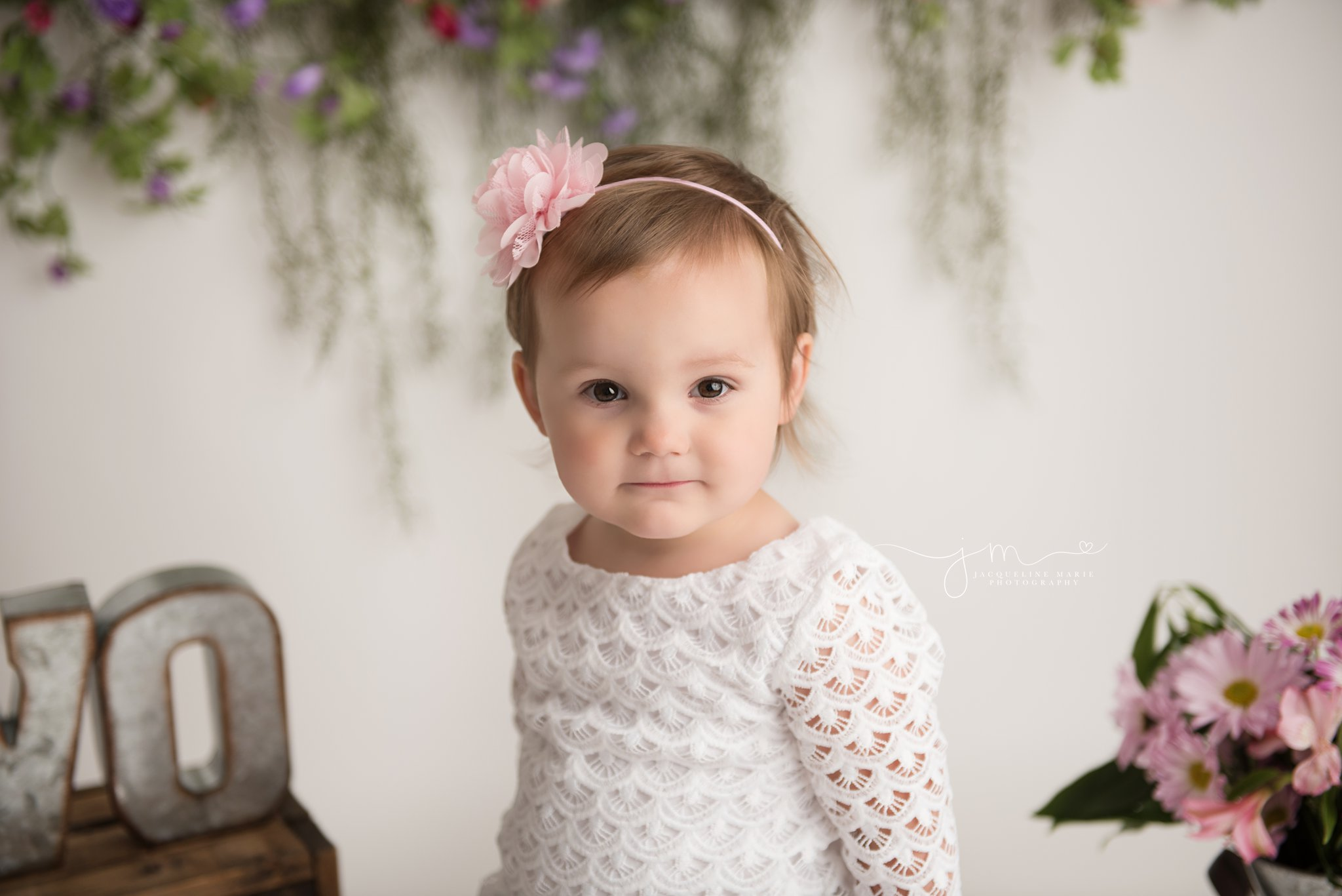 2 year old little girl wears pink floral headband for birthday milestone portraits in columbus ohio