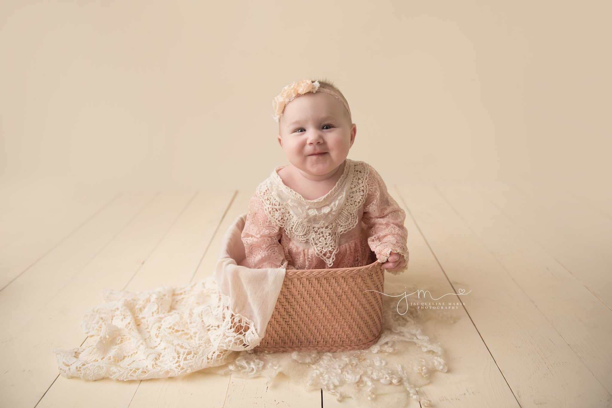 columbus ohio baby photographer features images of sophia wearing pink lace romper and sitting in pink vintage basket