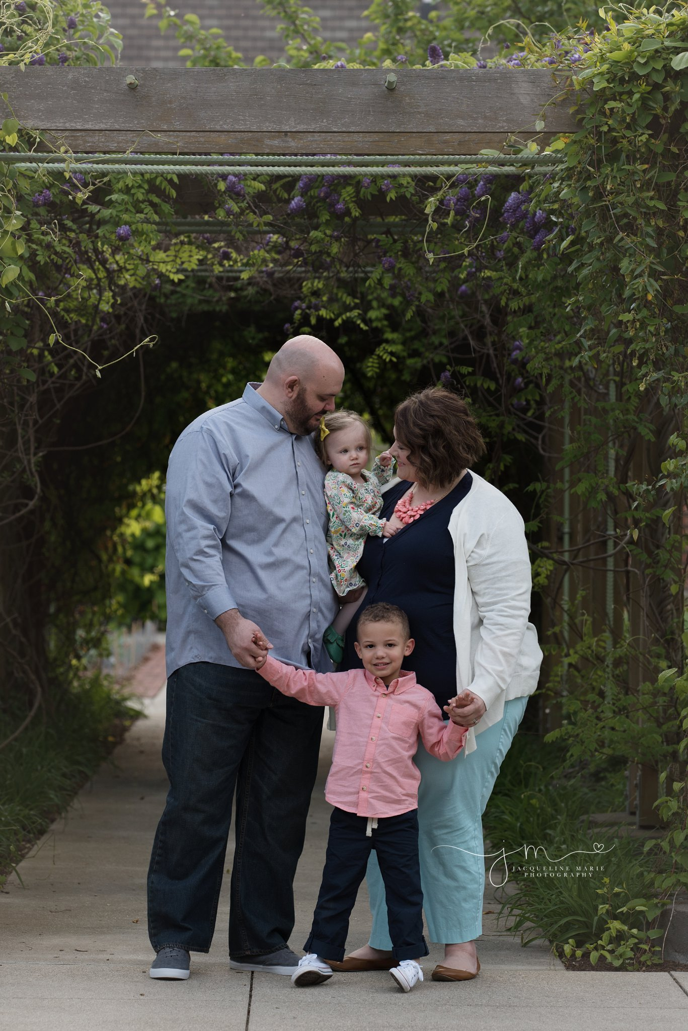 family of four holds hand for adoption family pictures in columbus ohio