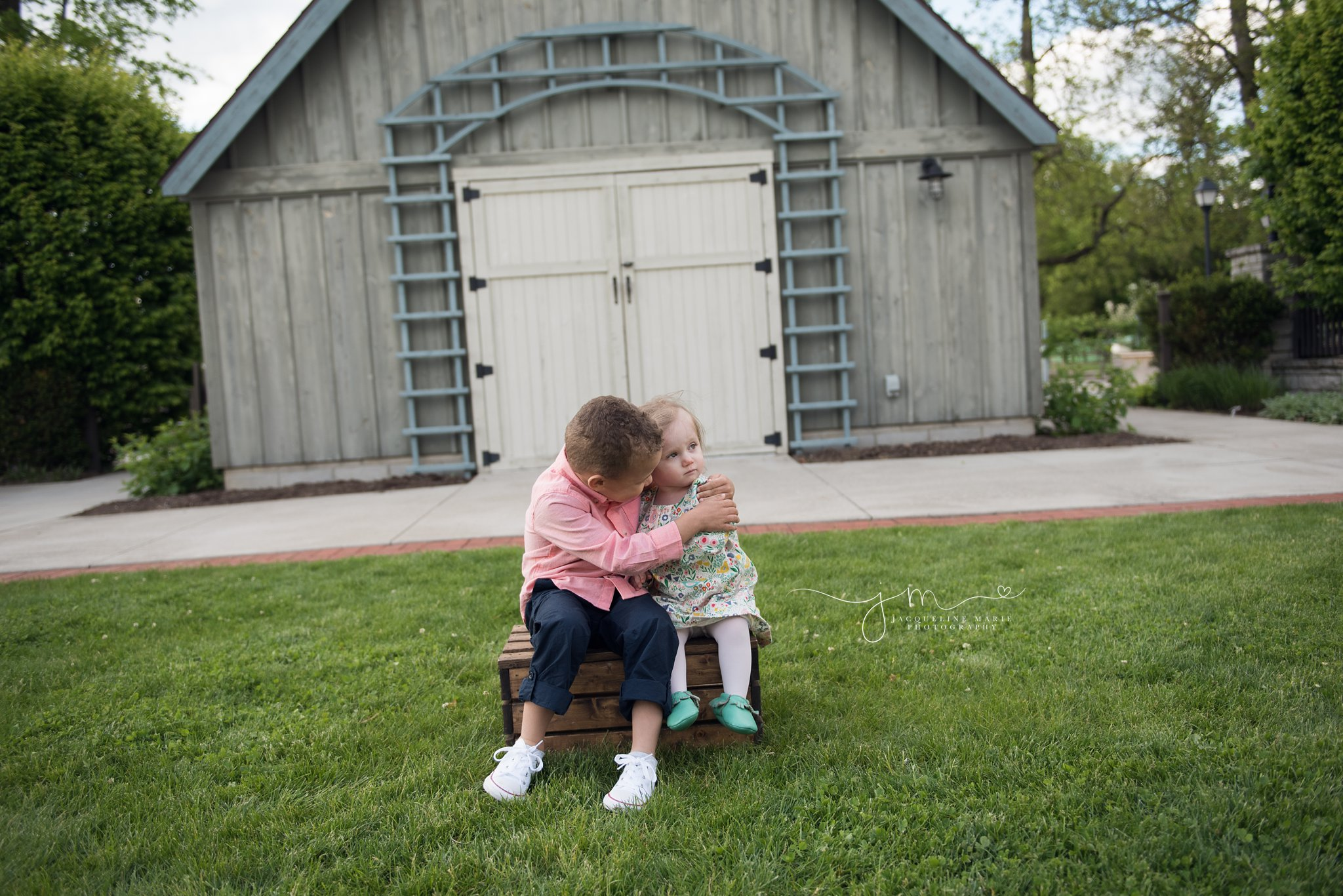 brother and sister share a hug to celebrate family adoption by columbus ohio family photographer