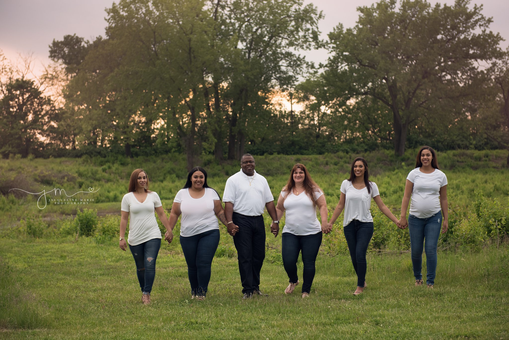 columbus ohio family photographer features images of mother and father walking with four daughters