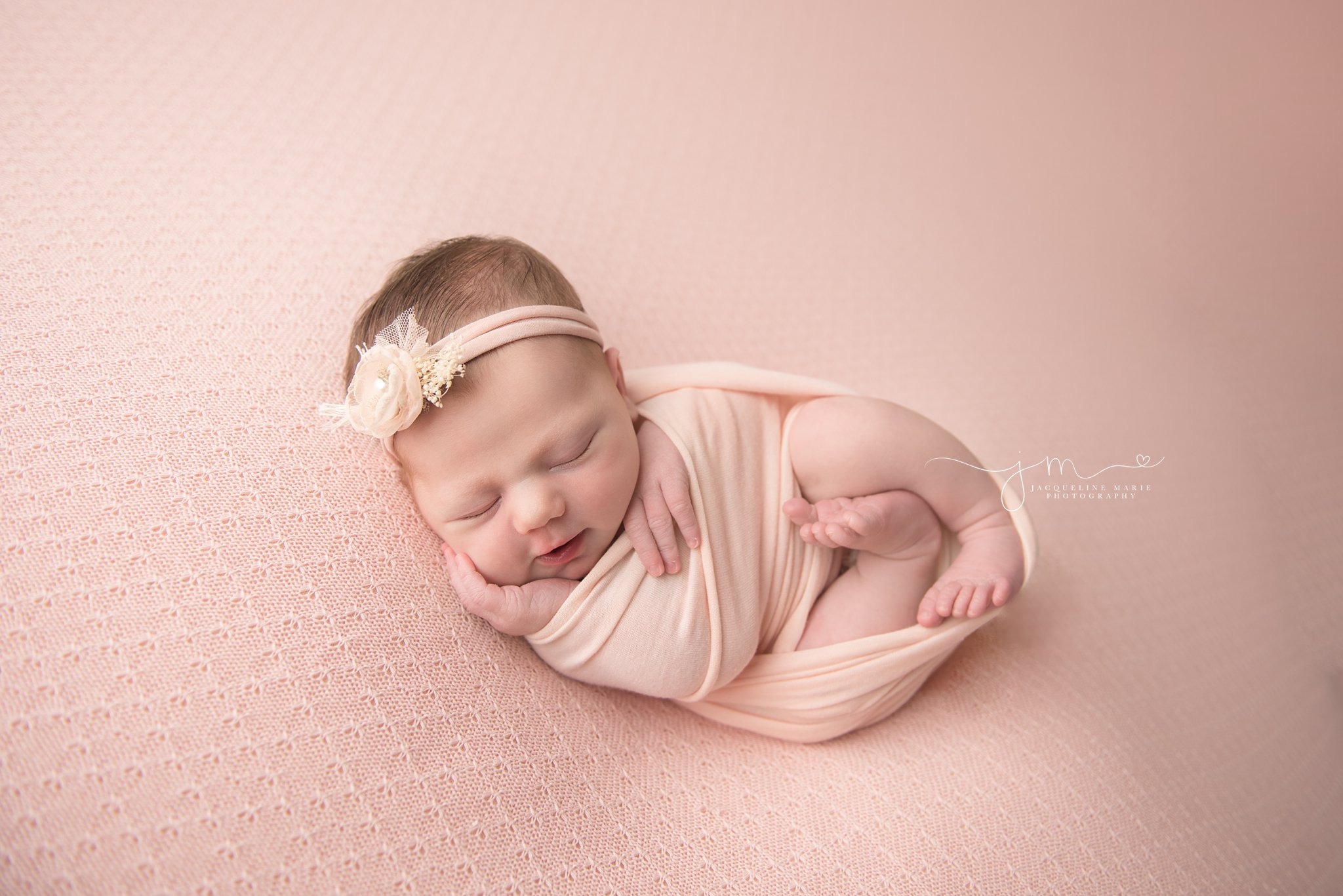 columbus ohio newborn photographer features images of baby girl wrapped in pink swaddle