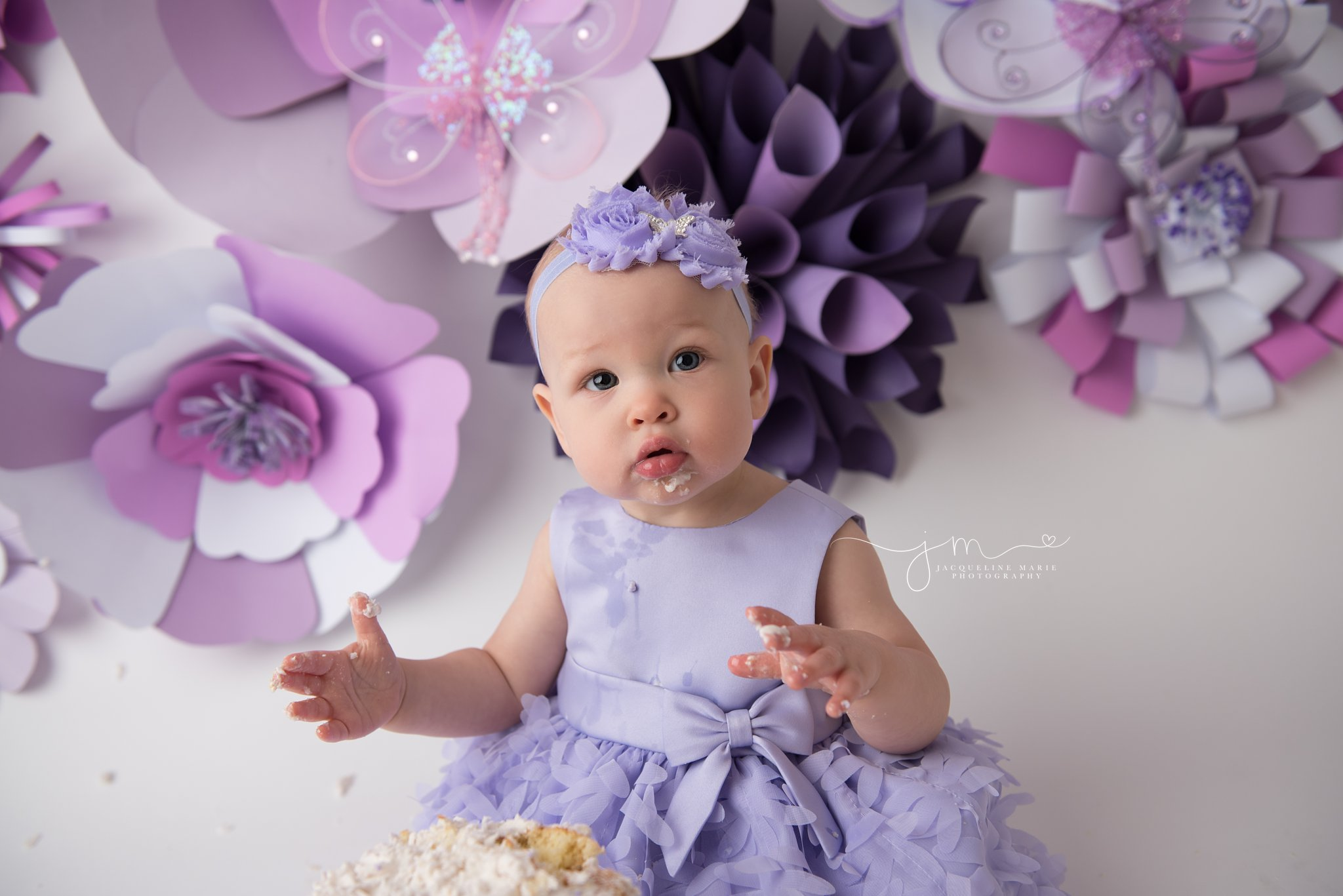 columbus ohio first birthday photographer features image of baby girl eating cake for first birthday pictures